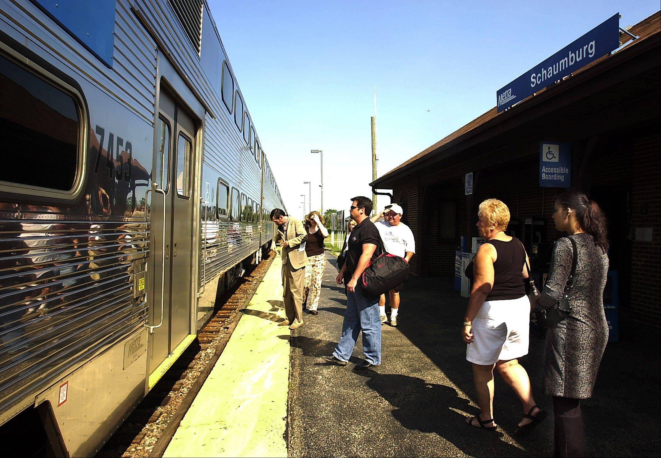 Metra riders board an afternoon train to Chicago.