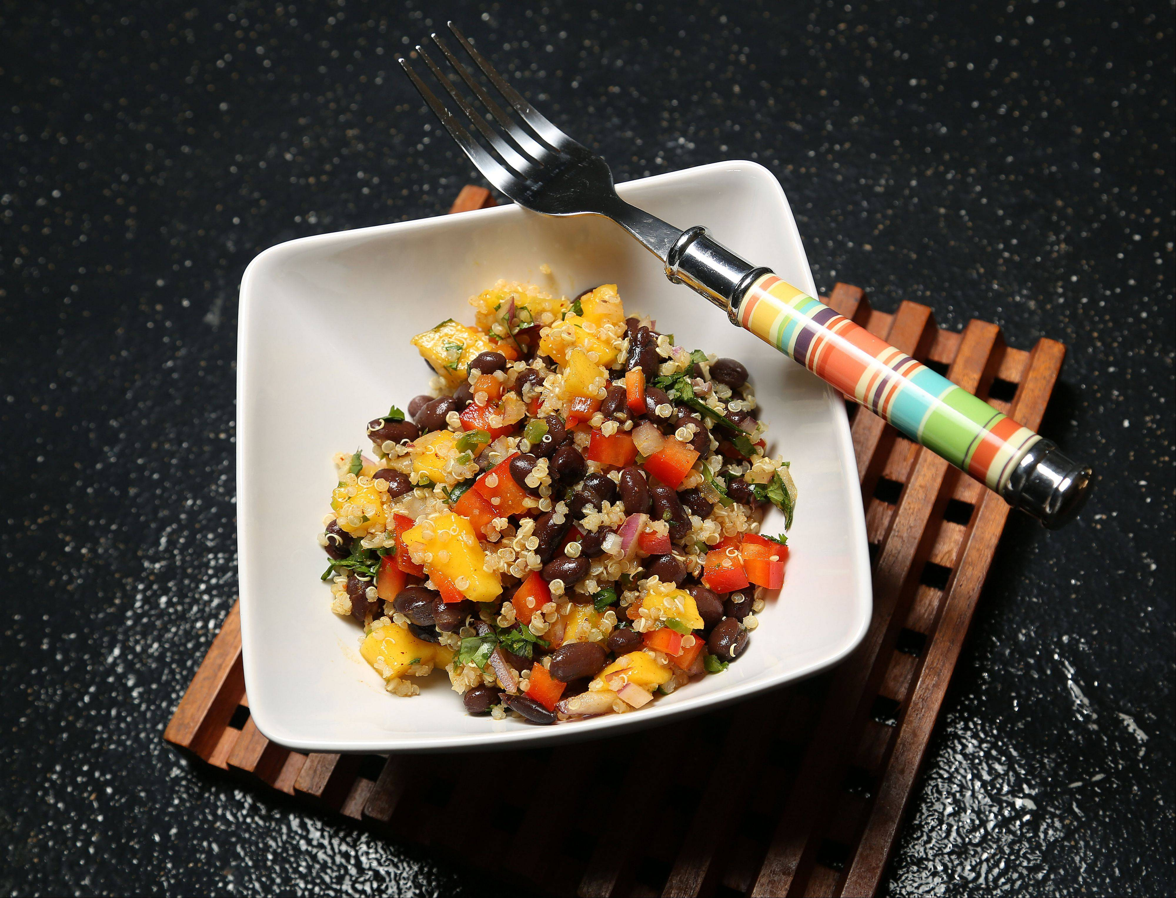 Mango adds a burst of flavor and nutrients to black bean and quinoa salad.