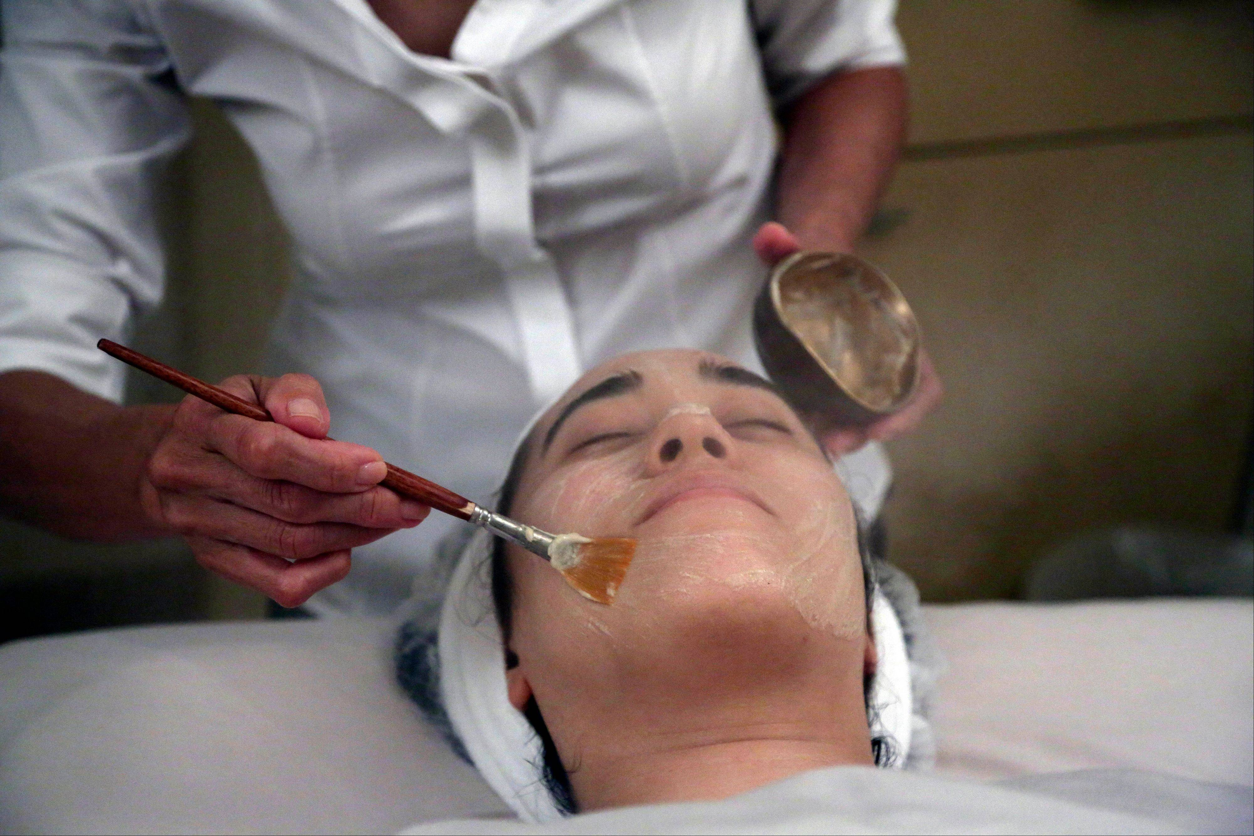 Salon owner Shizuka Bernstein gives what she calls a Geisha Facial to Mari Miyoshi at Shizuka New York skin care in New York. The facial, which Bernstein has been offered for five years, is a traditional Japanese treatment using imported Asian nightingale excrement mixed with rice bran, and goes for $180 a pop.