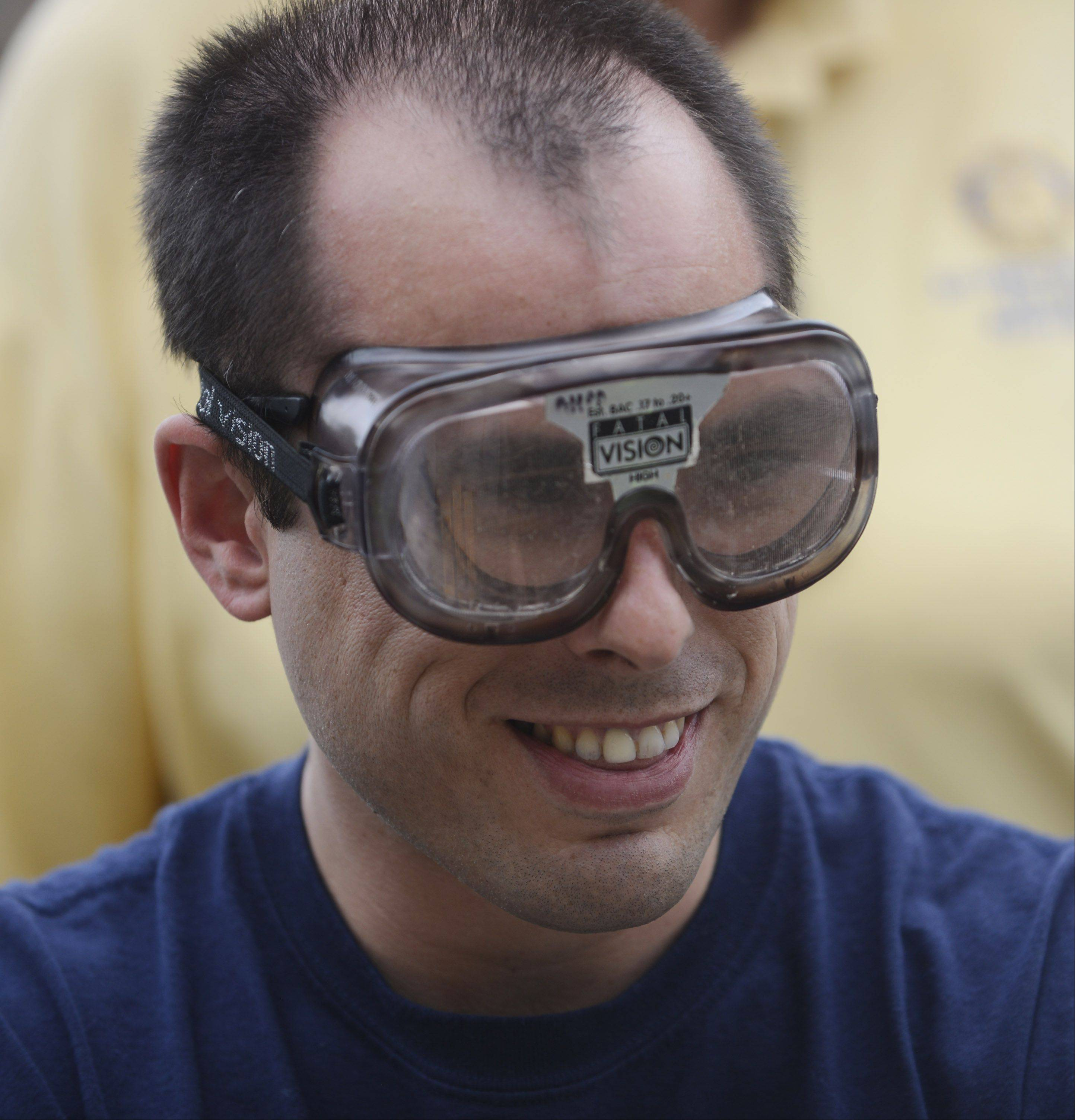 "Mischa Schlichting of Arlington Heights wears ""Fatal Vision"" goggles while participating in a demonstration to show the effects of impaired driving during the Arlington Heights National Night Out at North School Park Tuesday."