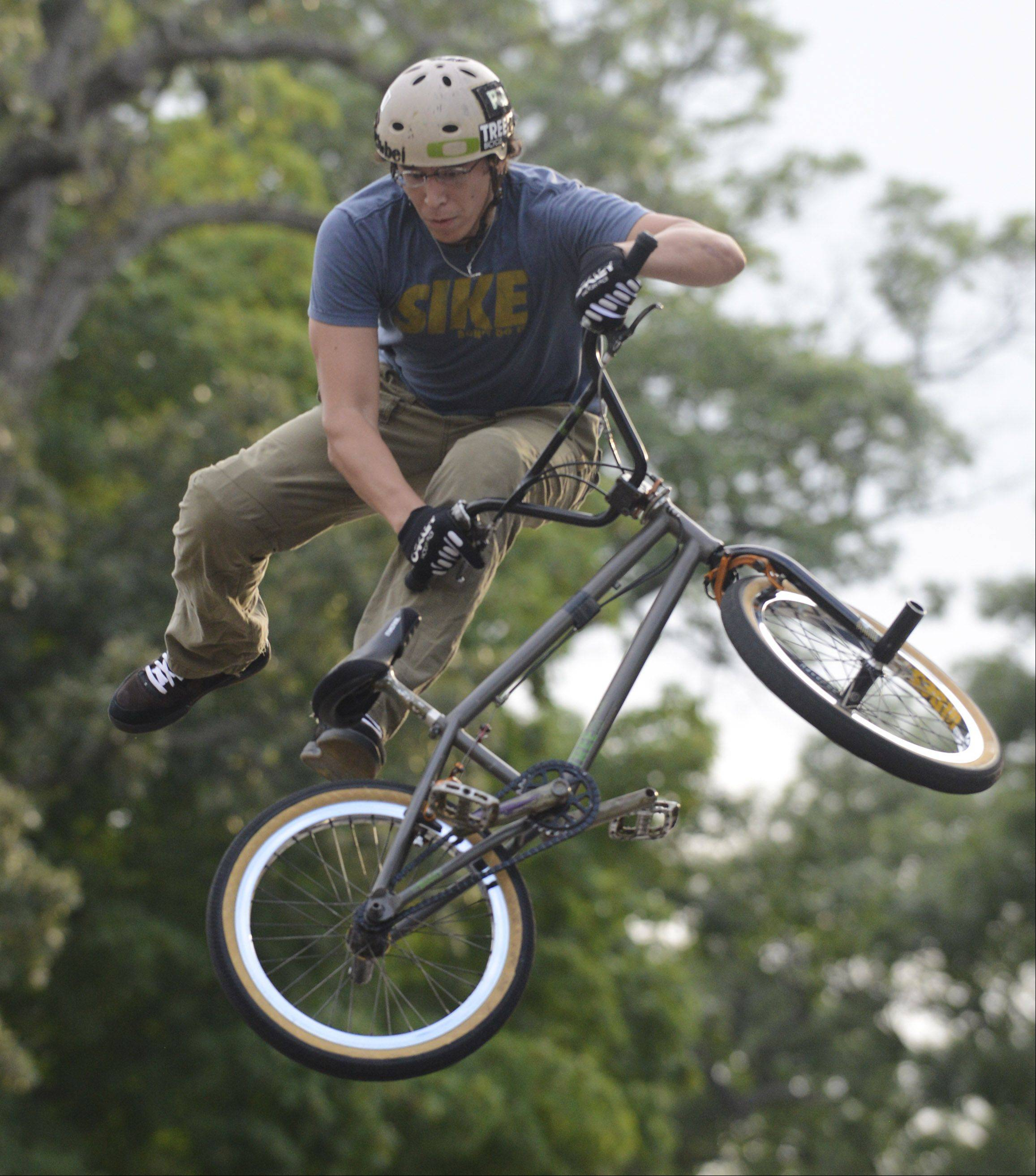Koji Kraft of Addison performs a stunt during the Division BMX Stunt Show during the Bartlett National Night Out at Bartlett Park Tuesday.