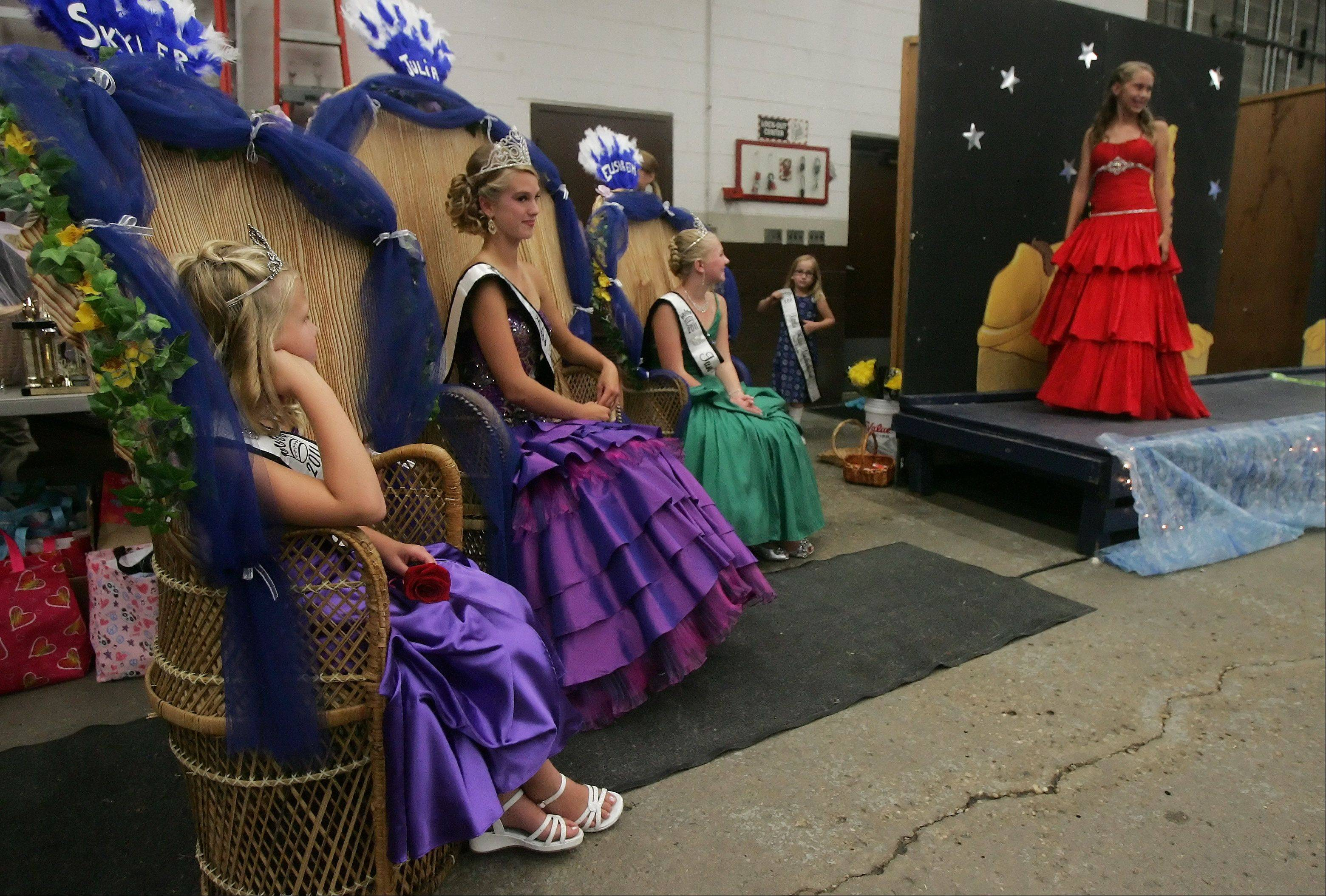 2011 Little Miss Lindenfest Skyler Przanowski, left, Miss Lindenhurst Julia Bauschke and Junior Miss Elisabeth Mies watch as Mya Pfeifer, 12, walks across the stage during last year's pageant on the first day of Lindenfest.