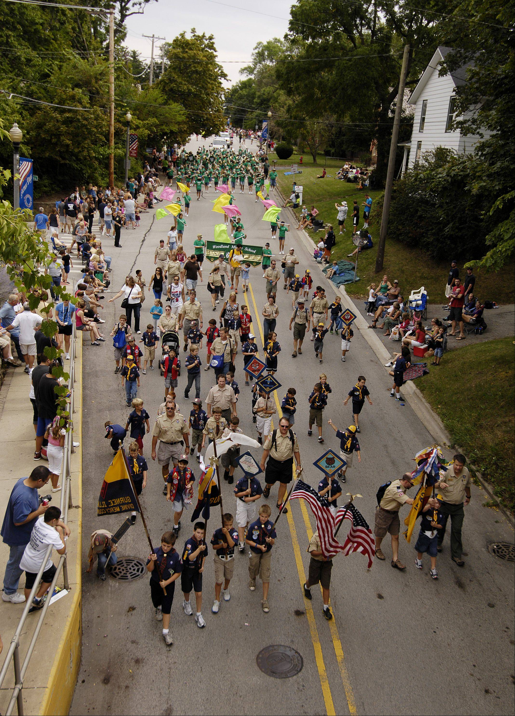 Cub Scouts march in the Gurnee Days parade down Old Grand Avenue on the festival's finale last year.
