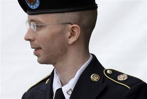 In this July 30, 2013 file photo, Army Pfc. Bradley Manning is escorted out of a courthouse in Fort Meade, Md. after receiving a verdict in his court martial. A military judge has reduced Manning's maximum possible sentence in the WikiLeaks case to 90 years in prison.