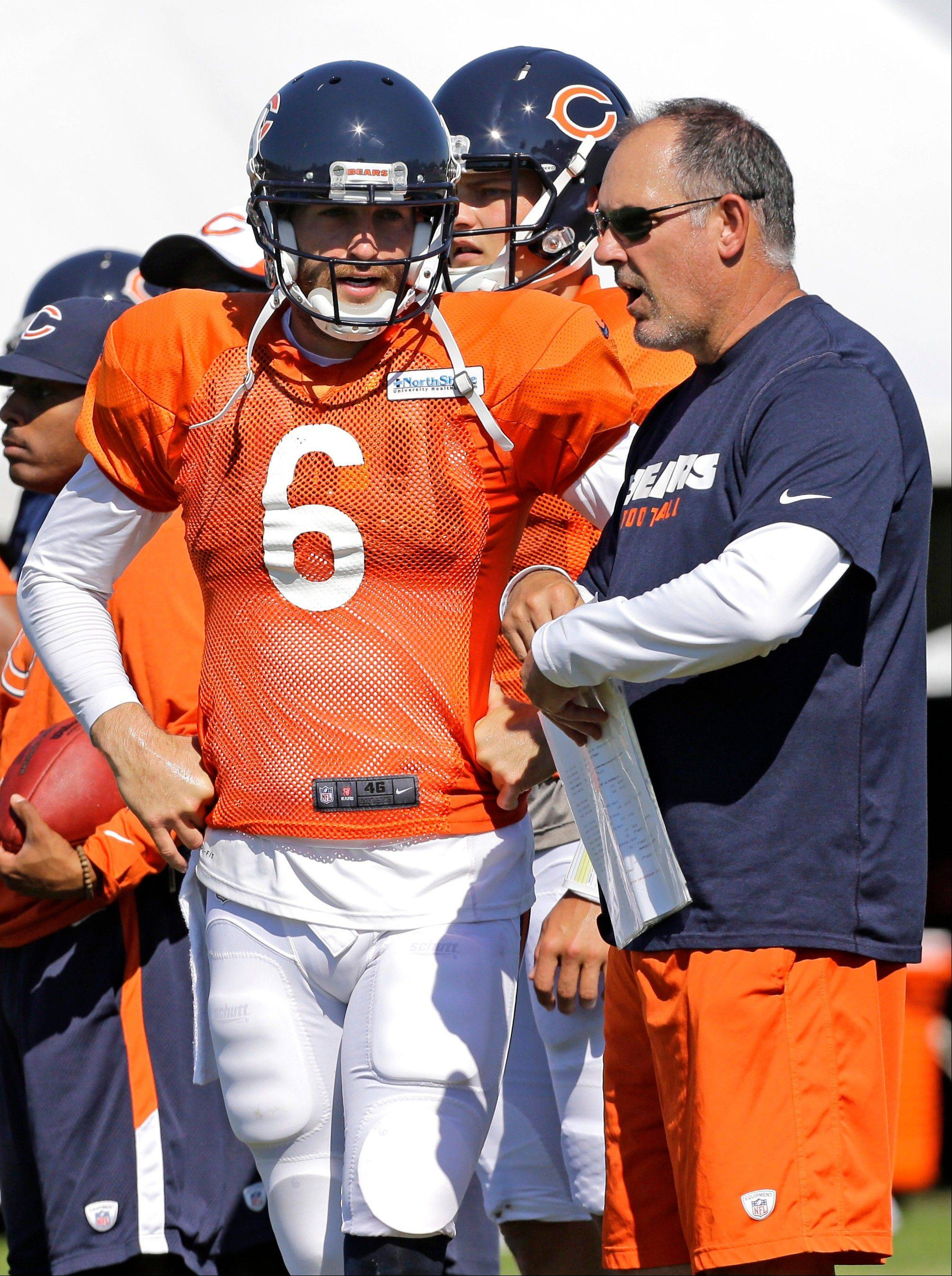 Bears quarterback coach Matt Cavanaugh talks with quarterback Jay Cutler during a training-camp workout.