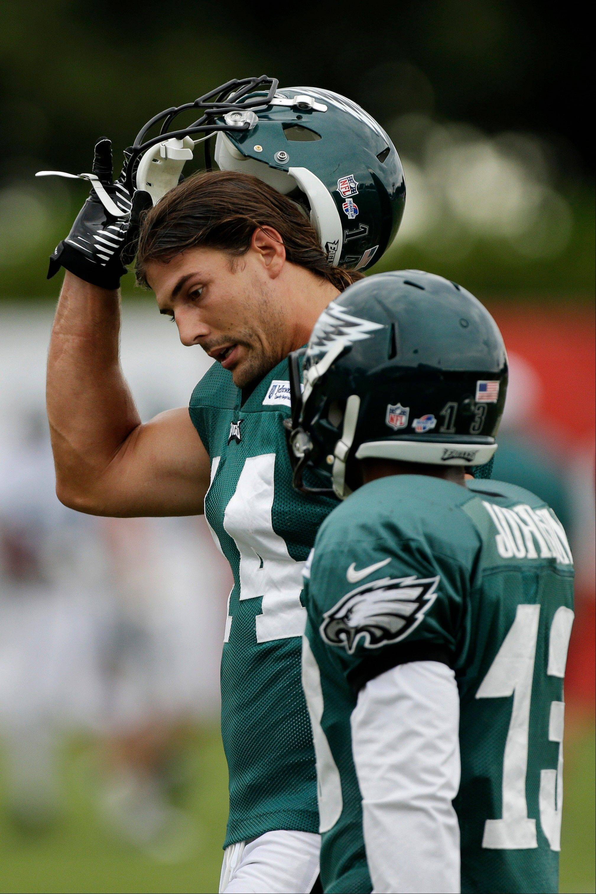 Philadelphia Eagles wide receivers Riley Cooper, left, and Damaris Johnson talk during a joint NFL football workout with the New England Patriots, Tuesday, Aug. 6, 2013, in Philadelphia.