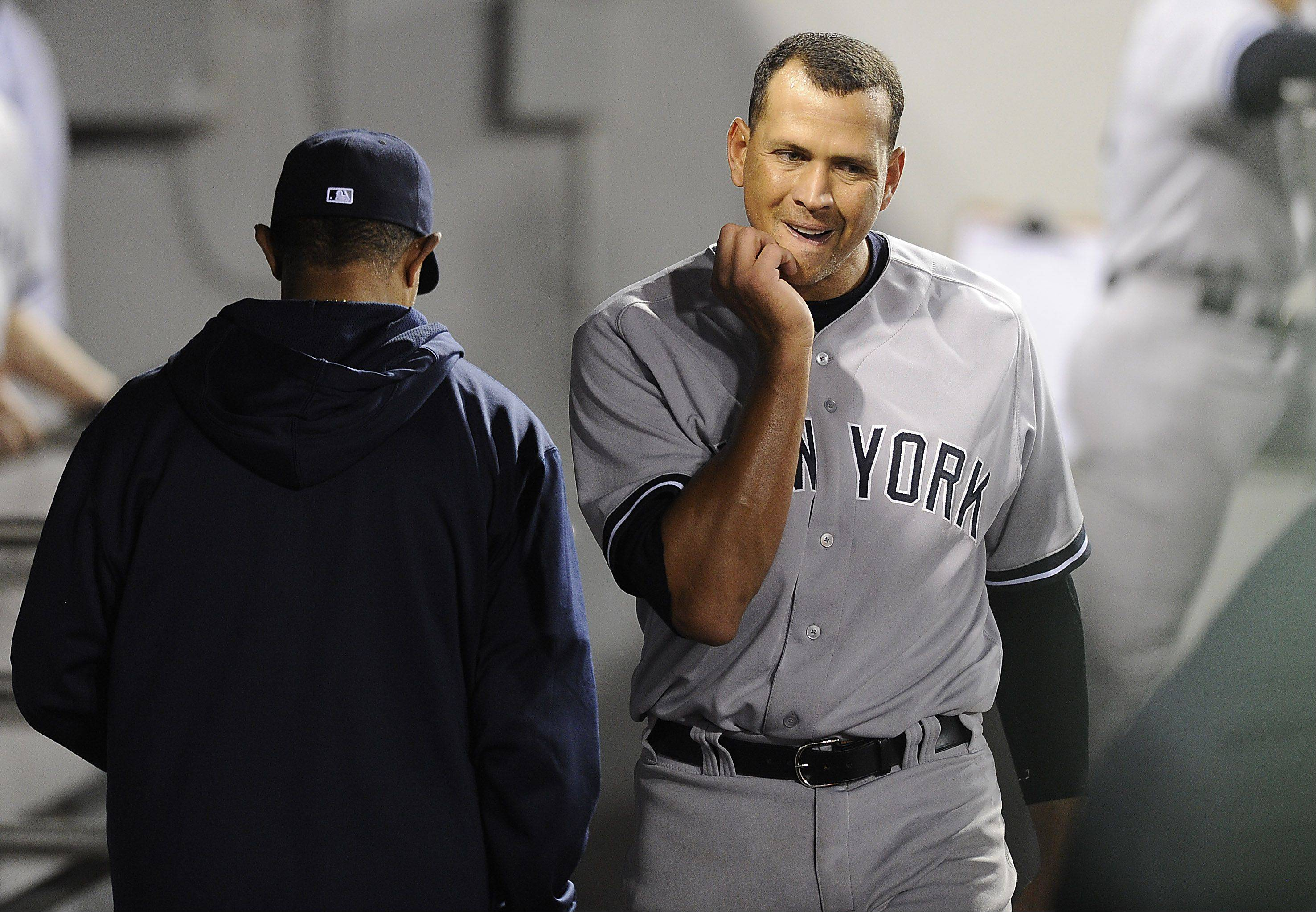 The Yankees' Alex Rodriguez walks through the dugout after striking out in the eighth inning Monday night at Cellular Field in Chicago.