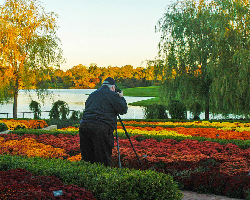 Peter Young (shown here photographing The Chicago Botanic Gardens) has won numerous awards for his lifelong passion.