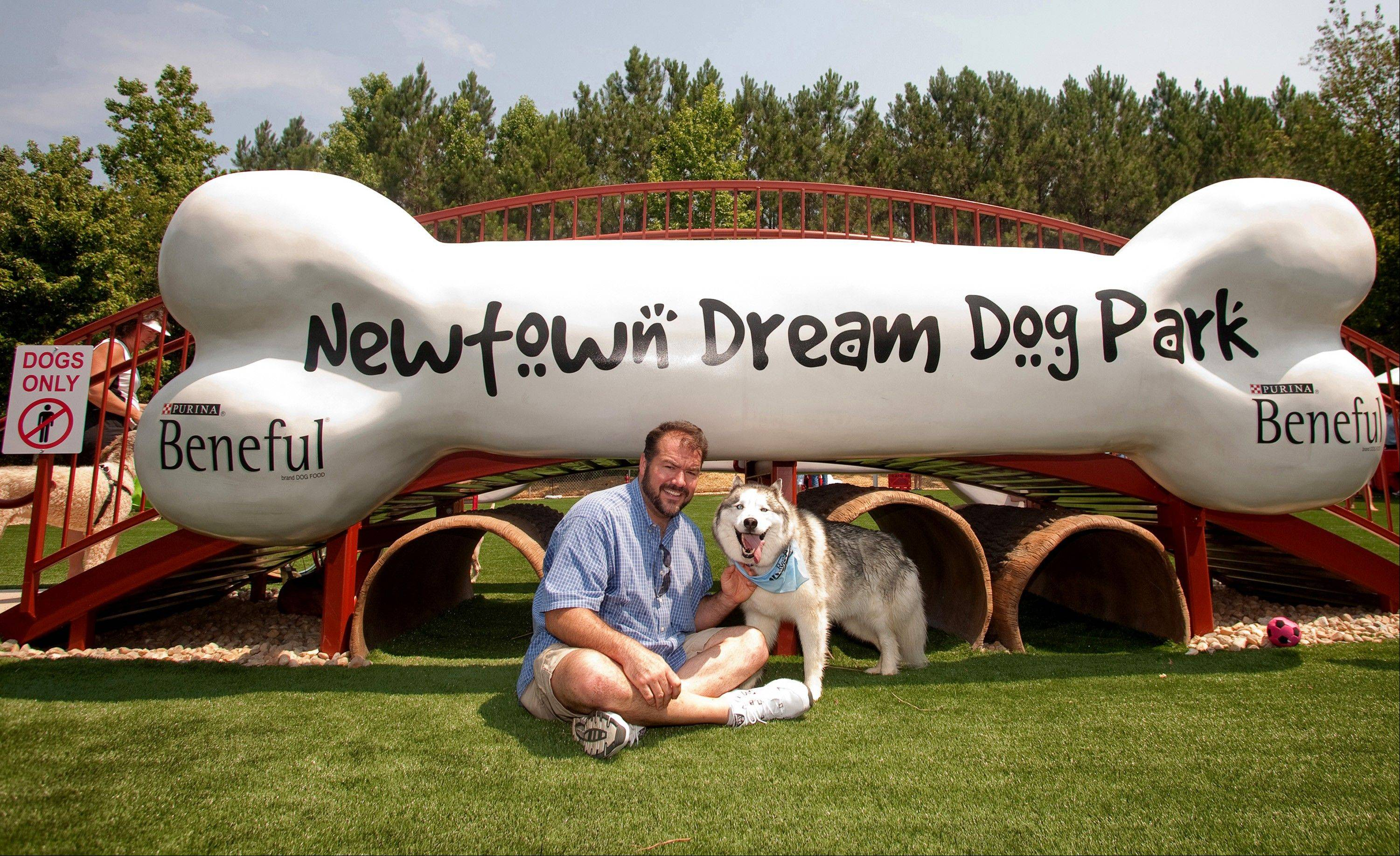 Grand Prize Winner of the 2010 Beneful Dream Dog Park Contest, Pat McNeely and Koda, at the unveiling of their Dream Dog Park in Johns Creek, Ga. The dog park offers water splash pads, a 3-D dog bone bridge and crawl tunnels.