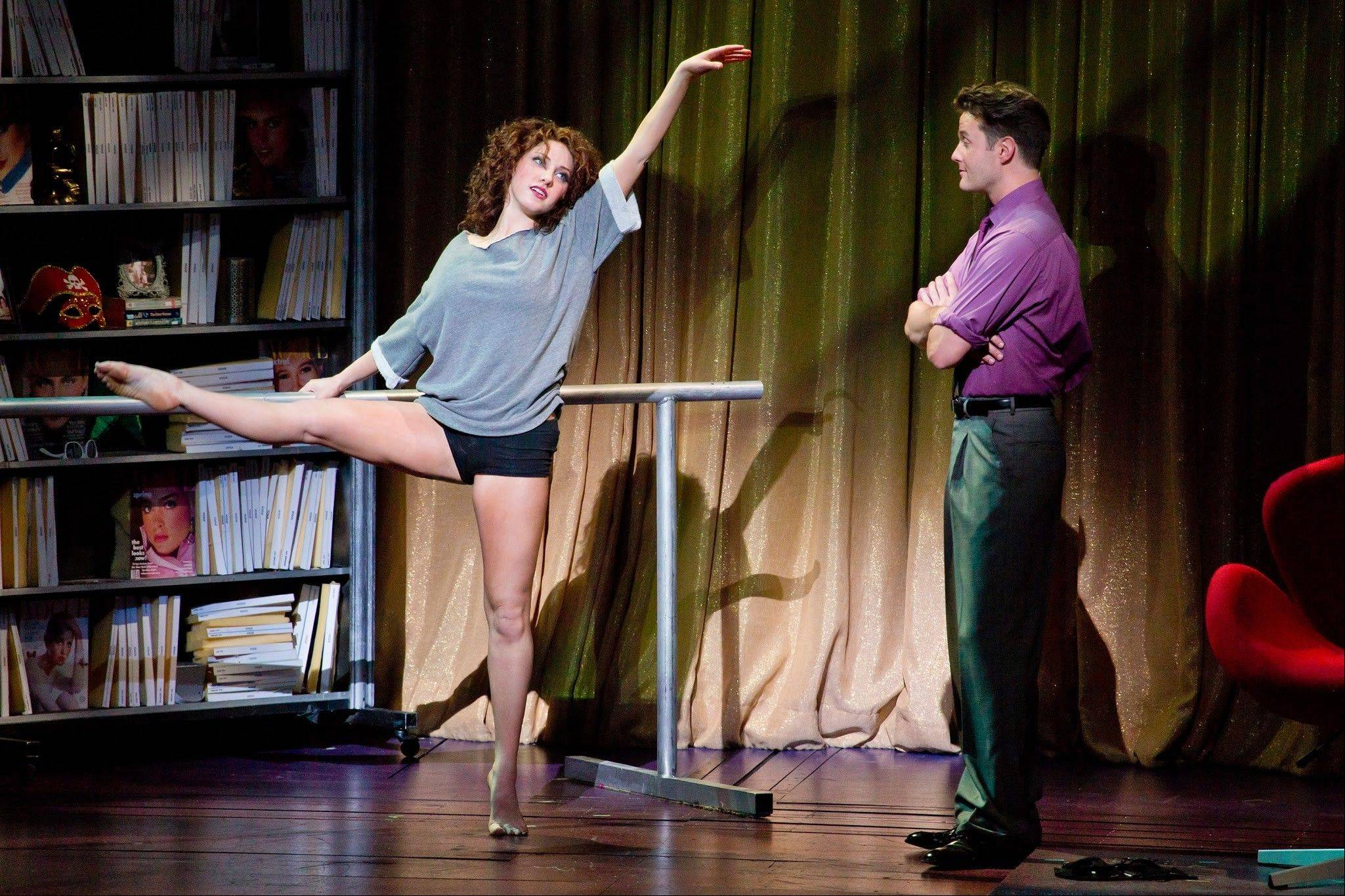 "Alex Owens (Jillian Mueller) tells Nick Hurley (Matthew Hydzik) of her dreams to become a professional dancer in ""Flashdance — The Musical,"" now playing at the Cadillac Palace Theatre in Chicago through Sunday, Aug. 18."