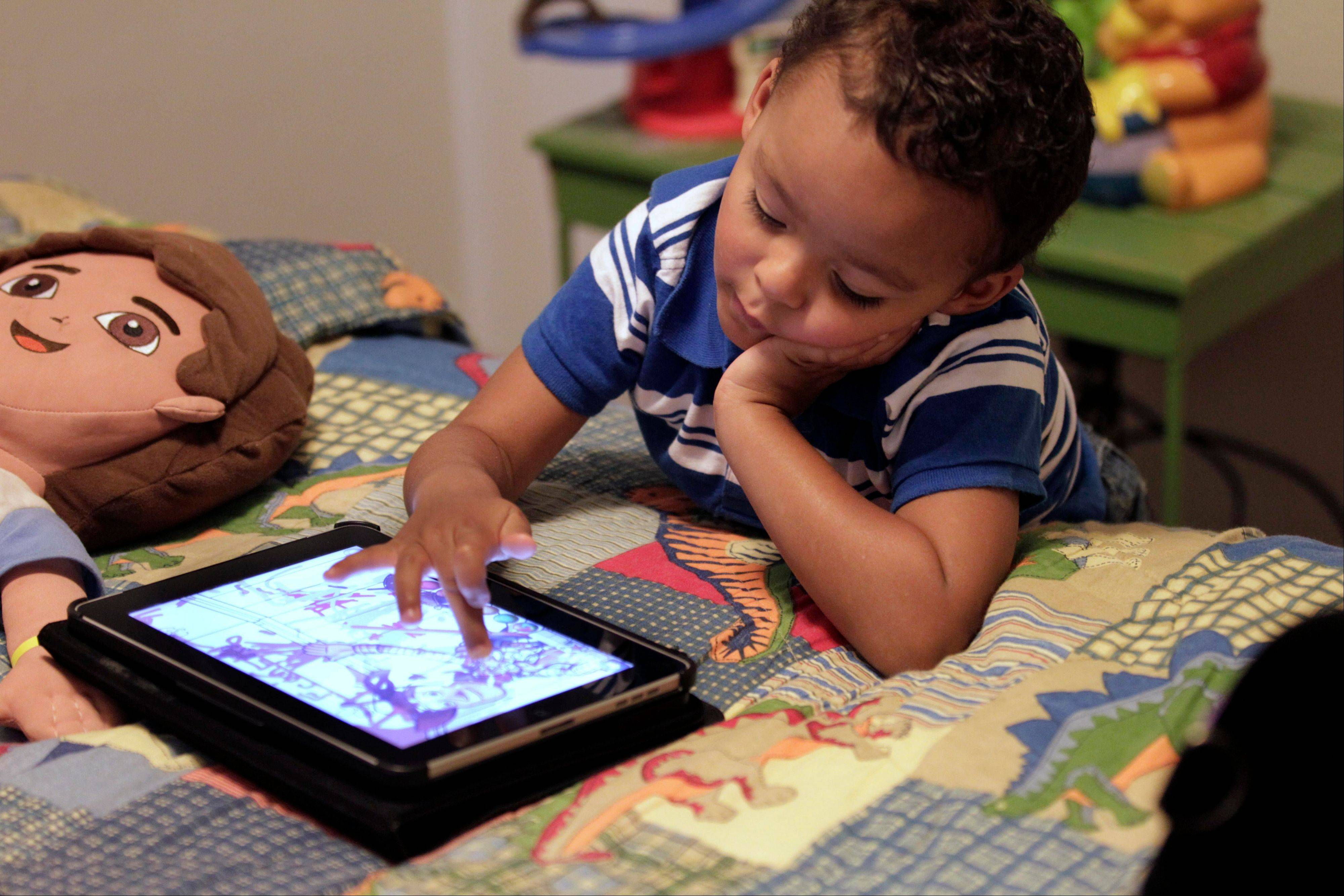 Frankie Thevenot, 3, plays with an iPad in his bedroom at his home in Metairie, La. The Campaign for a Commercial-Free Childhood, a Boston-based group, is urging federal investigators to examine the marketing practices of Fisher-Price�s and Open Solution�s mobile apps.