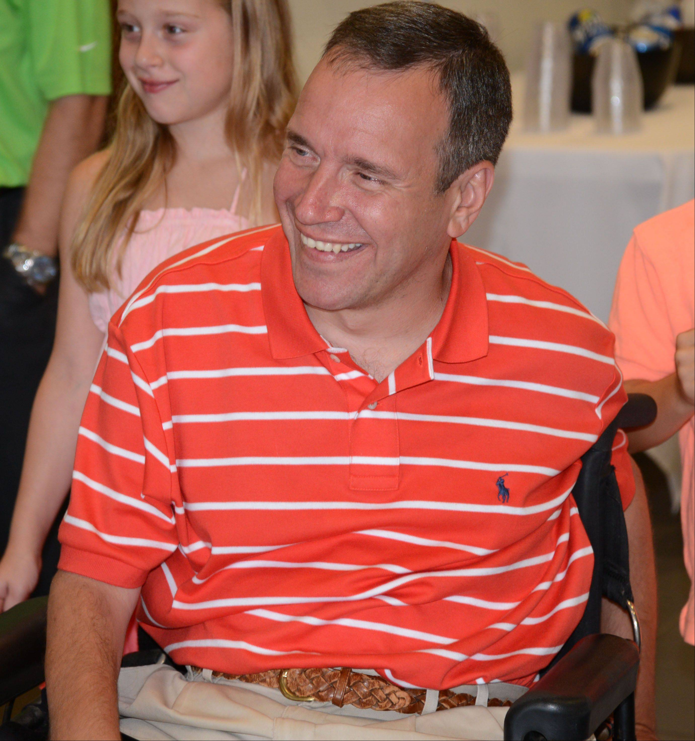 Steve Herbst of Palatine is all smiles Wednesday as he thanks the Local Heroes Contest for his new Honda Odyssey at Mobility Works in Villa Park. Herbst was paralyzed in 1980 while playing football at Palatine High School. He's one of the winners of the Local Heroes Contest sponsored by the National Mobility Equipment Dealers Association, VMI and San Tan Honda.