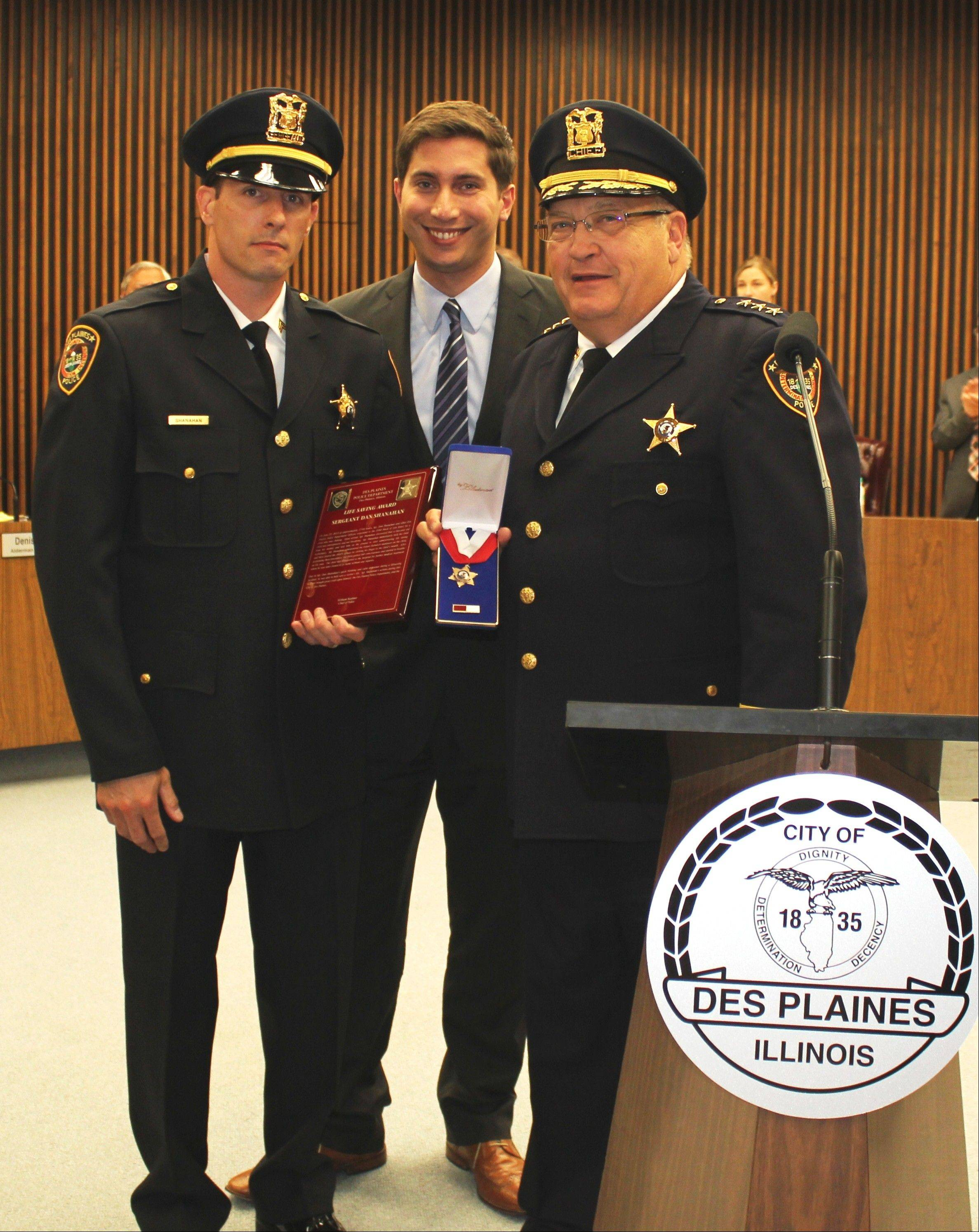 From left, Des Plaines Police Sgt. Dan Shanahan, Mayor Matt Bogusz, and Police Chief William Kushner pose for a photograph after Shanahan was presented with the Life Saving Award at the Aug. 5 city council meeting.