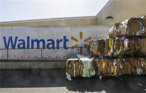 In this May 28, 2013, file photo, recycled cardboard boxes are ready for transport outside a Walmart store in Duarte, Calif. Wal-Mart agreed Wednesday, Aug. 7, 2013, to improve safety conditions for employees who use trash compactors and cleaning chemicals at more than 2,800 stores as part of a settlement agreement with the Labor Department.