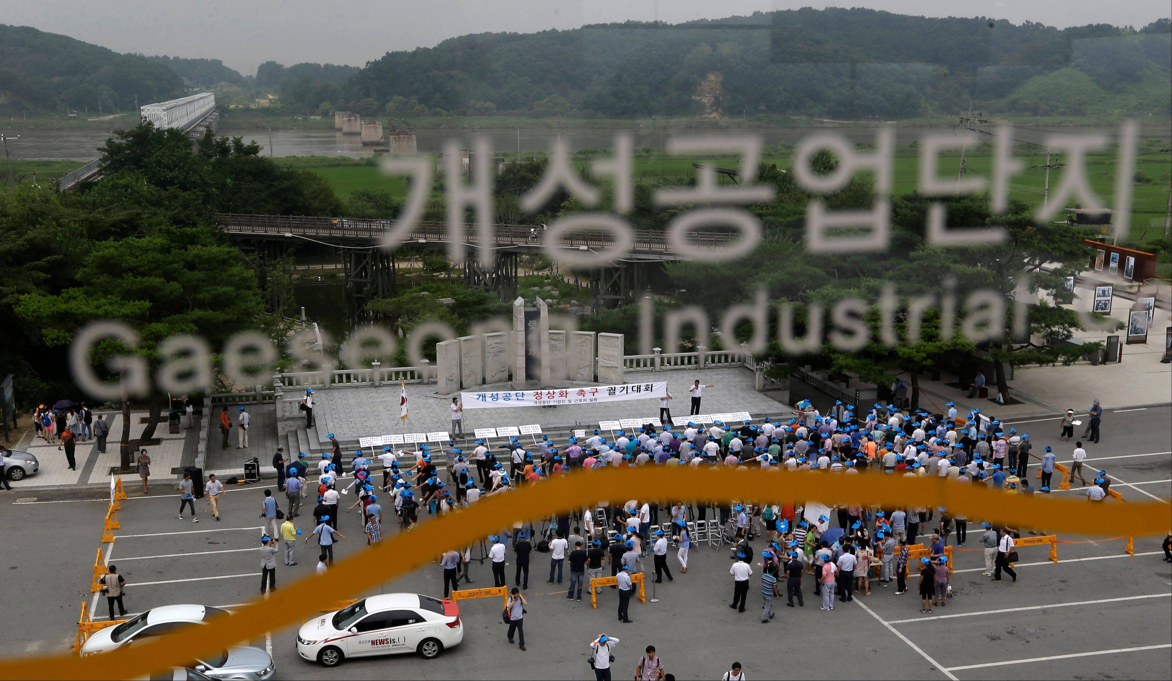 South Korean workers and owners who run factories in the stalled Kaesong industrial complex, the last symbol of inter-Korean cooperation, stage a rally insisting the normalize the operation of the industrial complex at the Imjingak Pavilion near the border village of Panmunjom, which has separated the two Koreas since the Korean War, in Paju, north of Seoul, South Korea, Wednesday, Aug. 7, 2013. About 500 owners and workers gathered near the border area for the rally.