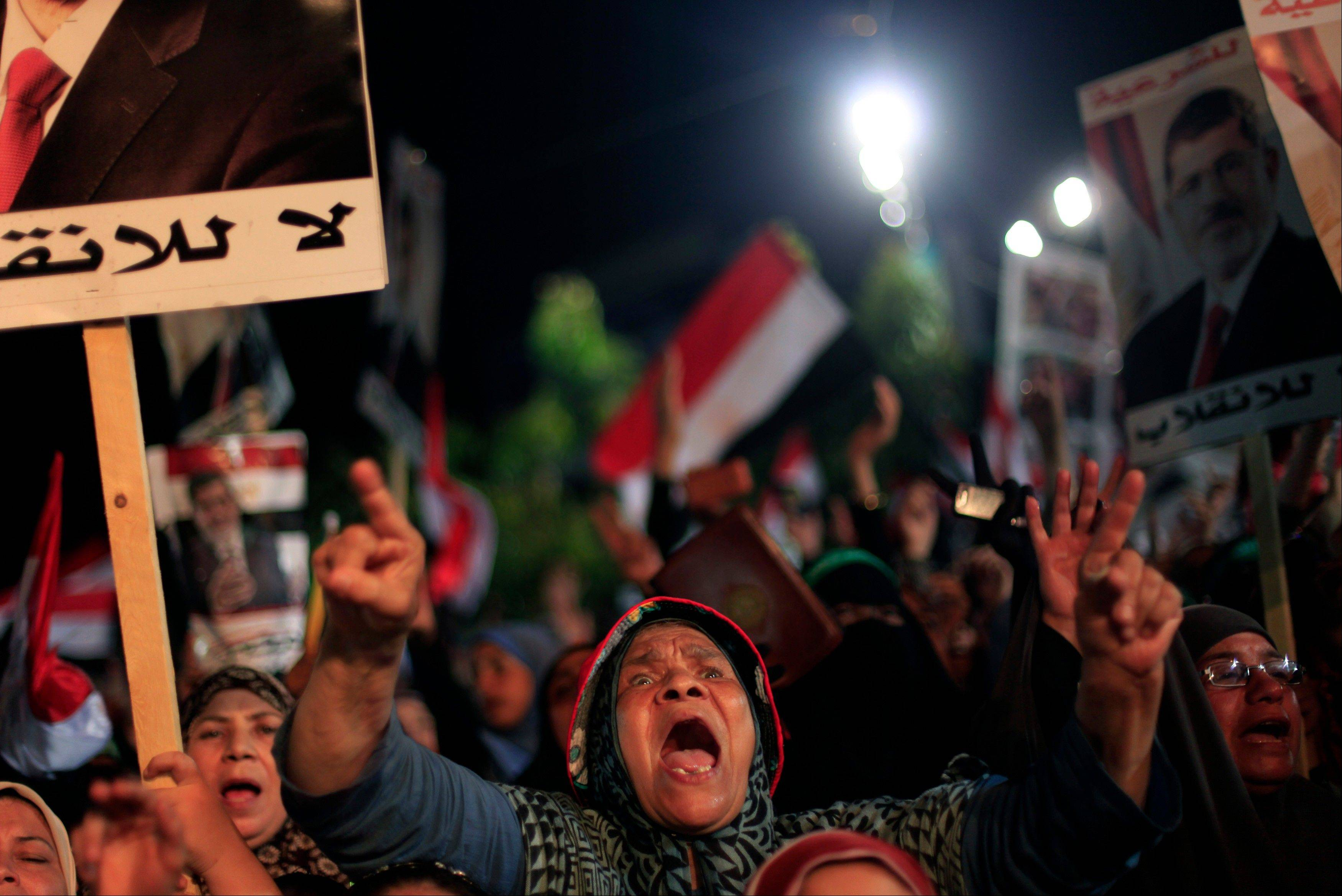 Supporters of Egypt�s ousted President Mohammed Morsi chant slogans and hold his posters with Arabic writing which reads �Yes for legality, No for the coup� during a protest outside Rabaah al-Adawiya mosque, where protesters have installed a camp and hold daily rallies.