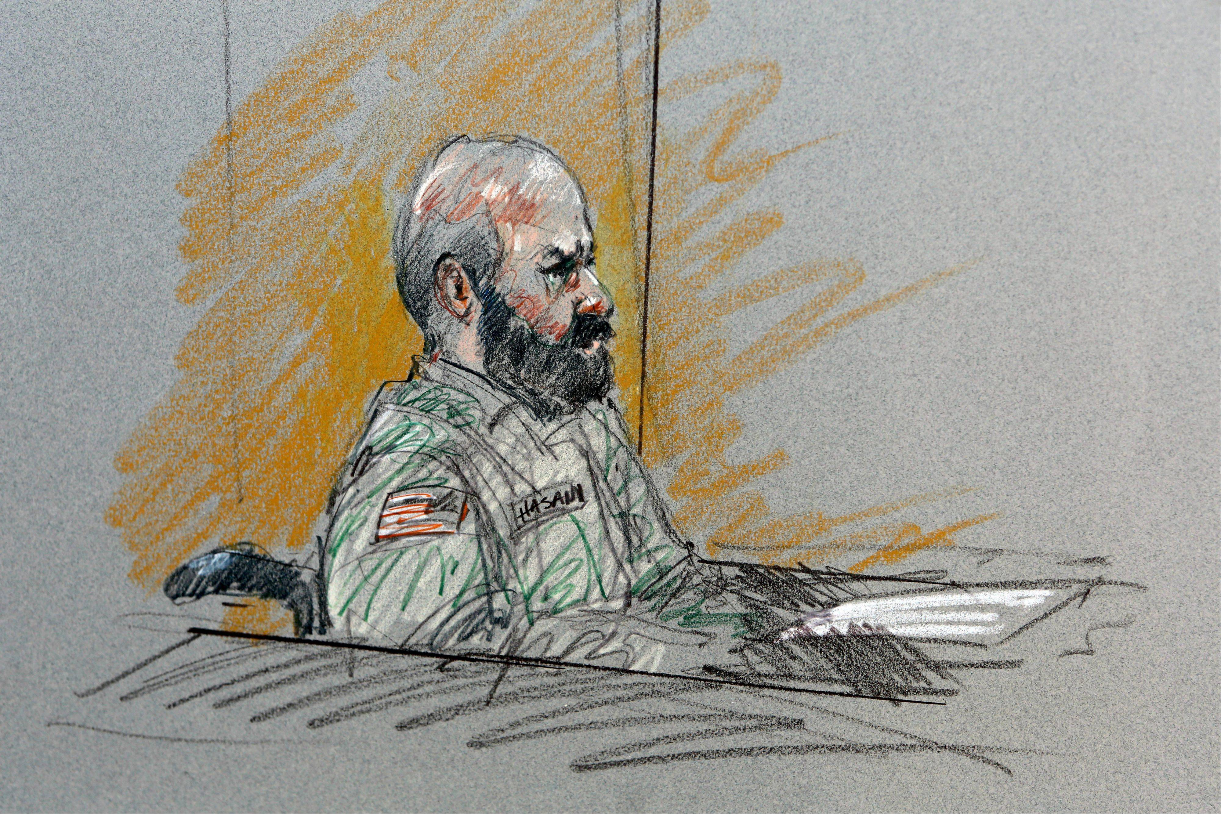 In this courtroom sketch, Maj. Nidal Hasan sits in court for his court-martial Tuesday in Fort Hood, Texas.