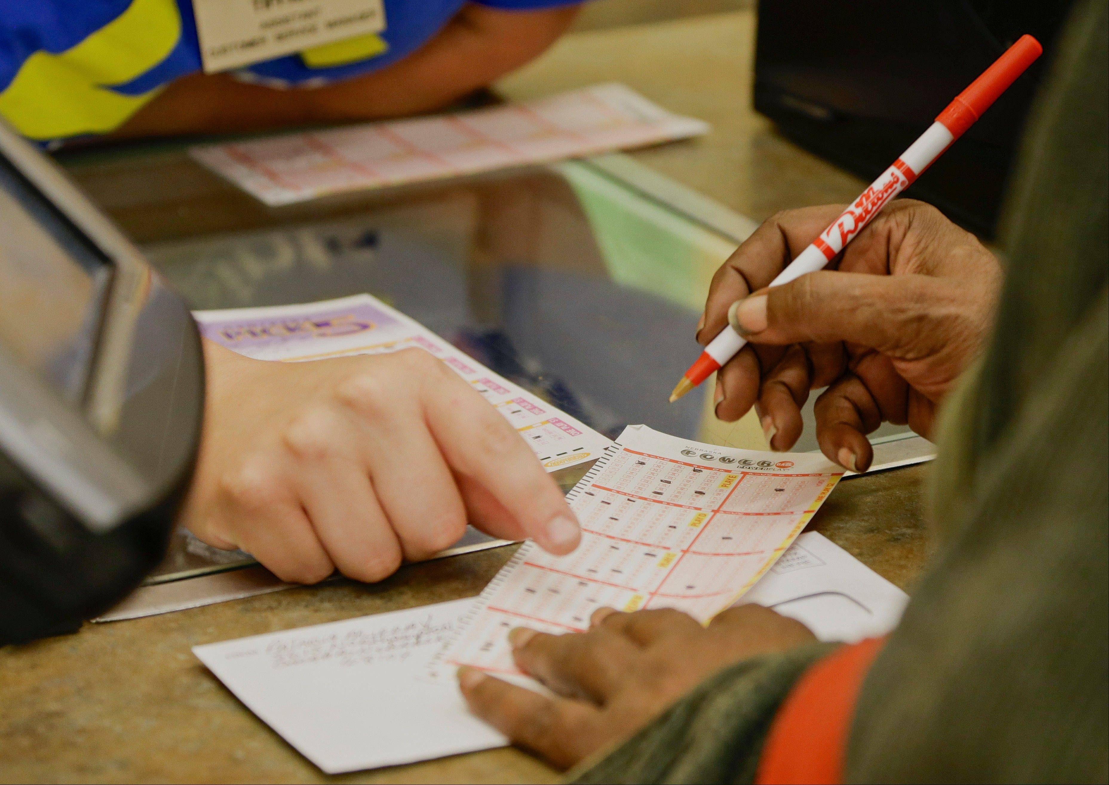 A customer fills out her powerball form at a Baker�s supermarket in Omaha, Neb., Tuesday, Aug. 6, 2013. Wednesday�s Powerball jackpot will be worth $425 million.