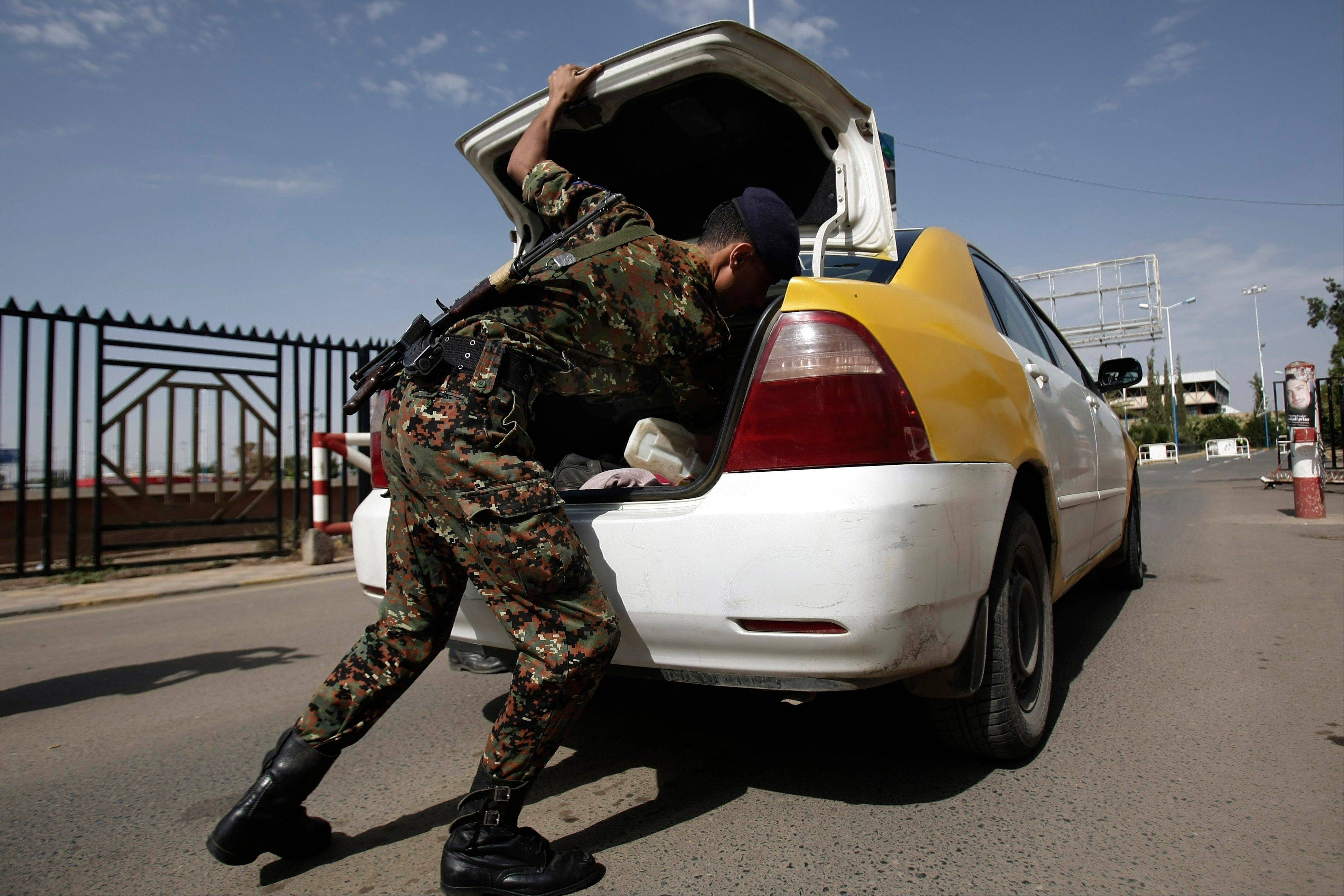 A policeman checks a car at the entrance of Sanaa International Airport, in Yemen, Wednesday, Aug. 7, 2013. The State Department on Tuesday ordered nonessential personnel at the U.S. Embassy in Yemen to leave the country.