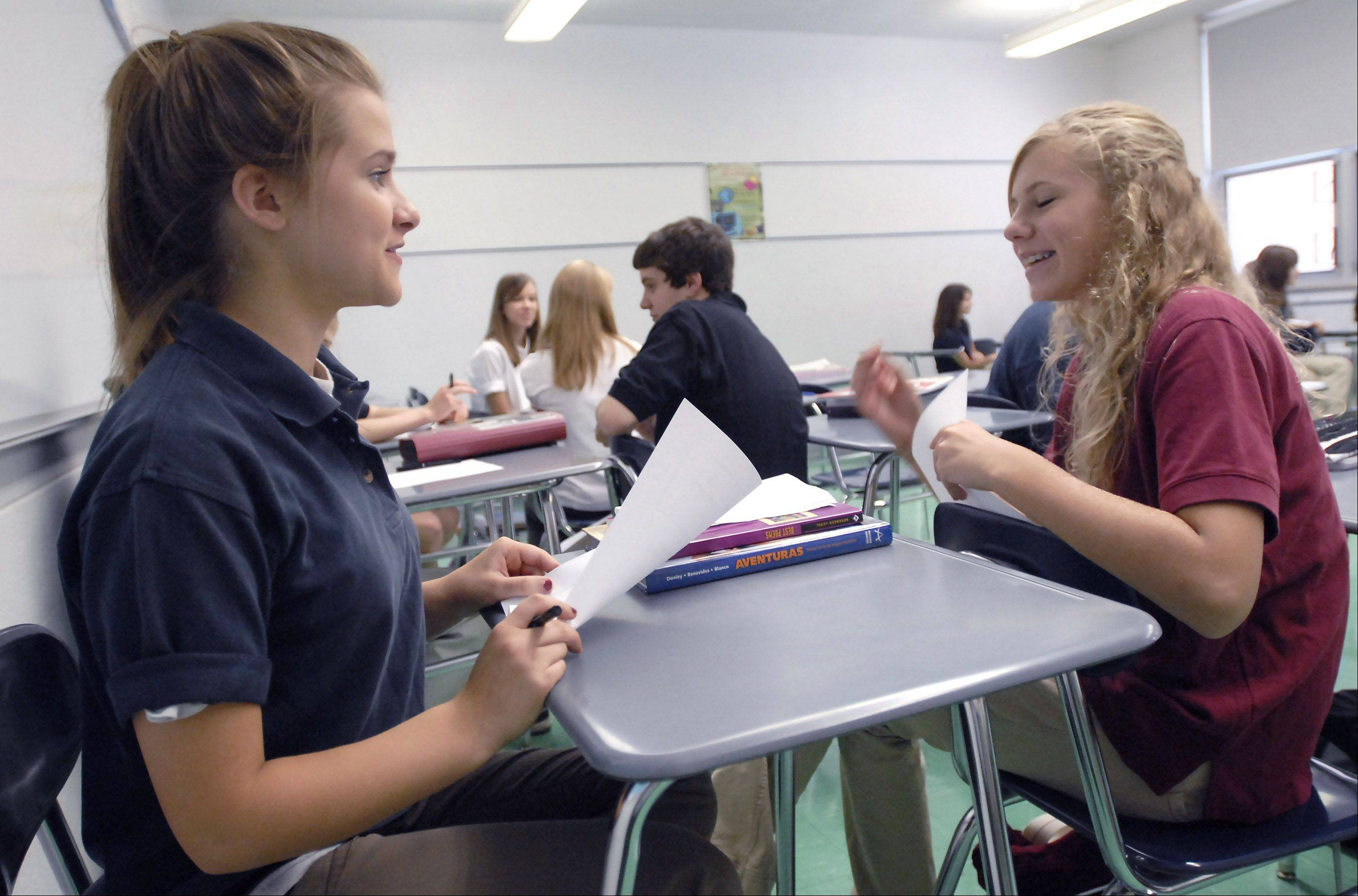 St. Viator freshman Brooke Bonk of Des Plaines and Emily Benas of Rolling Meadows trade life stories in a minute during Honors English class on the first day of school at St. Viator High School in Arlington Heights in 2006. This school year, the school will will start randomly testing all studentsl for alcohol consumption.