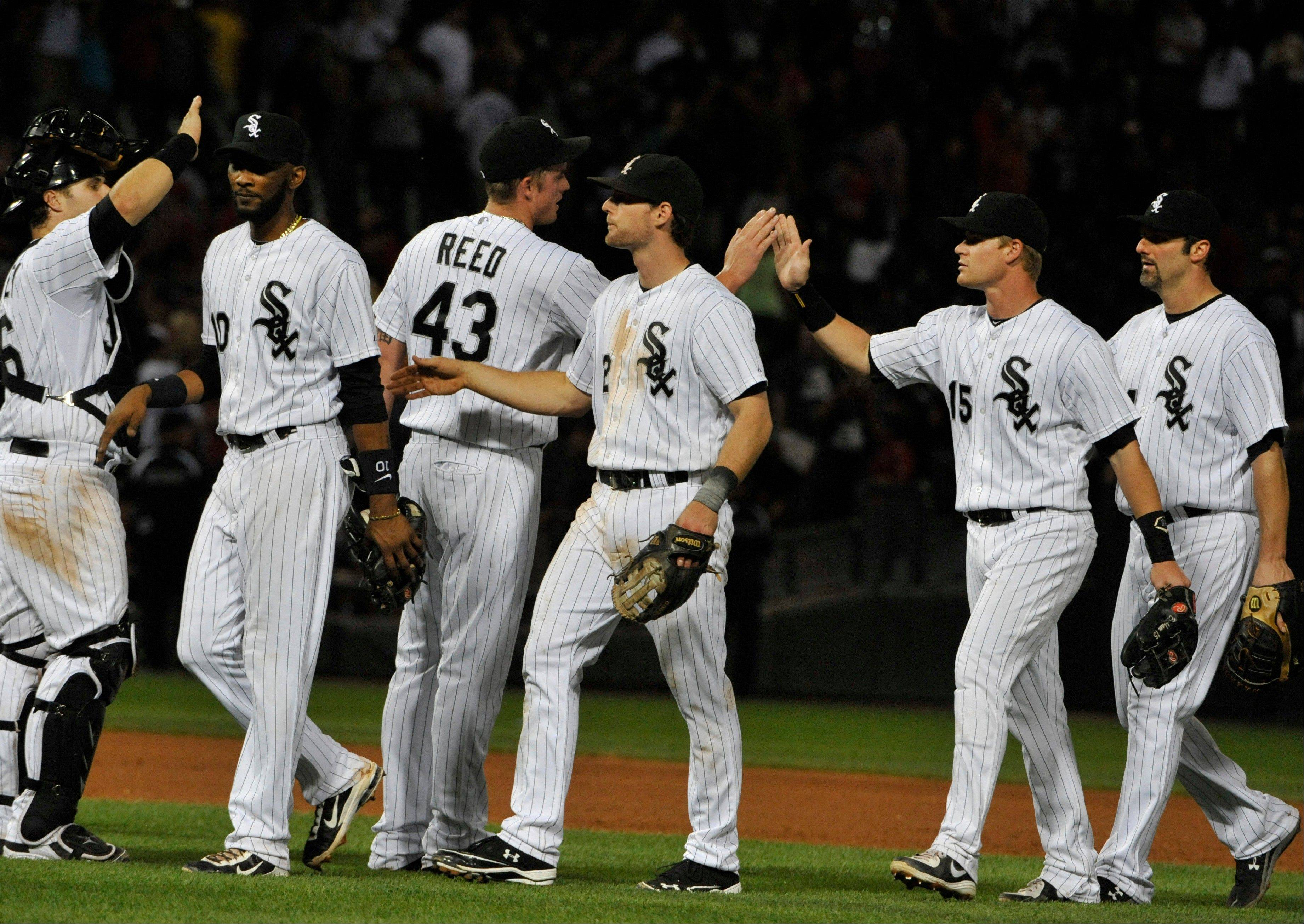 The Chicago White Sox celebrate their win in over the New York Yankees in a baseball game Tuesday, Aug. 6, 2013 in Chicago. The White Sox won 3-2. (AP Photo/David Banks)