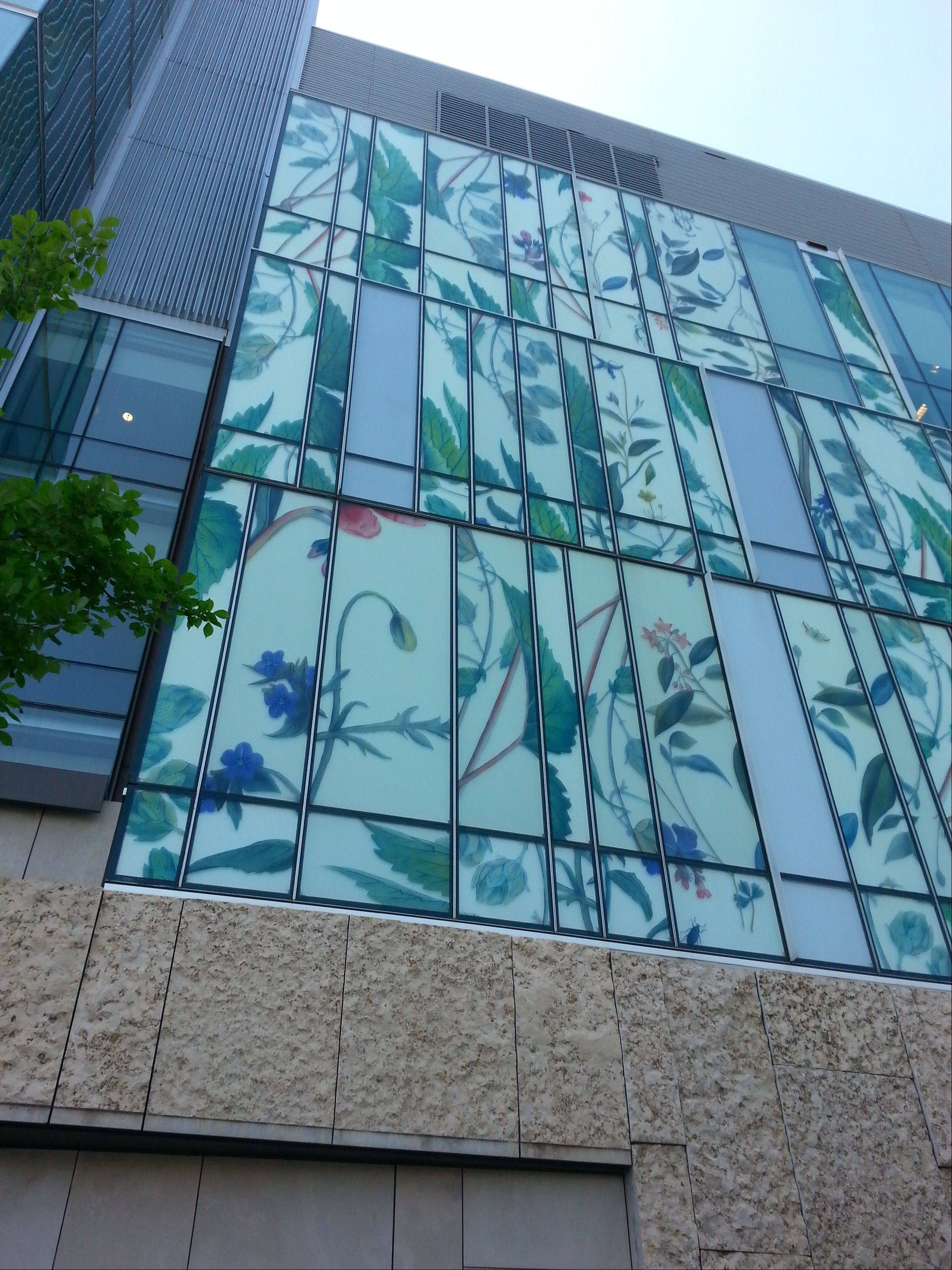 A a bird-friendly design at the School of Pharmacy at the University of Waterloo in Ontario, Canada uses a variety of different materials in addition to glass, including panels depicting plants.