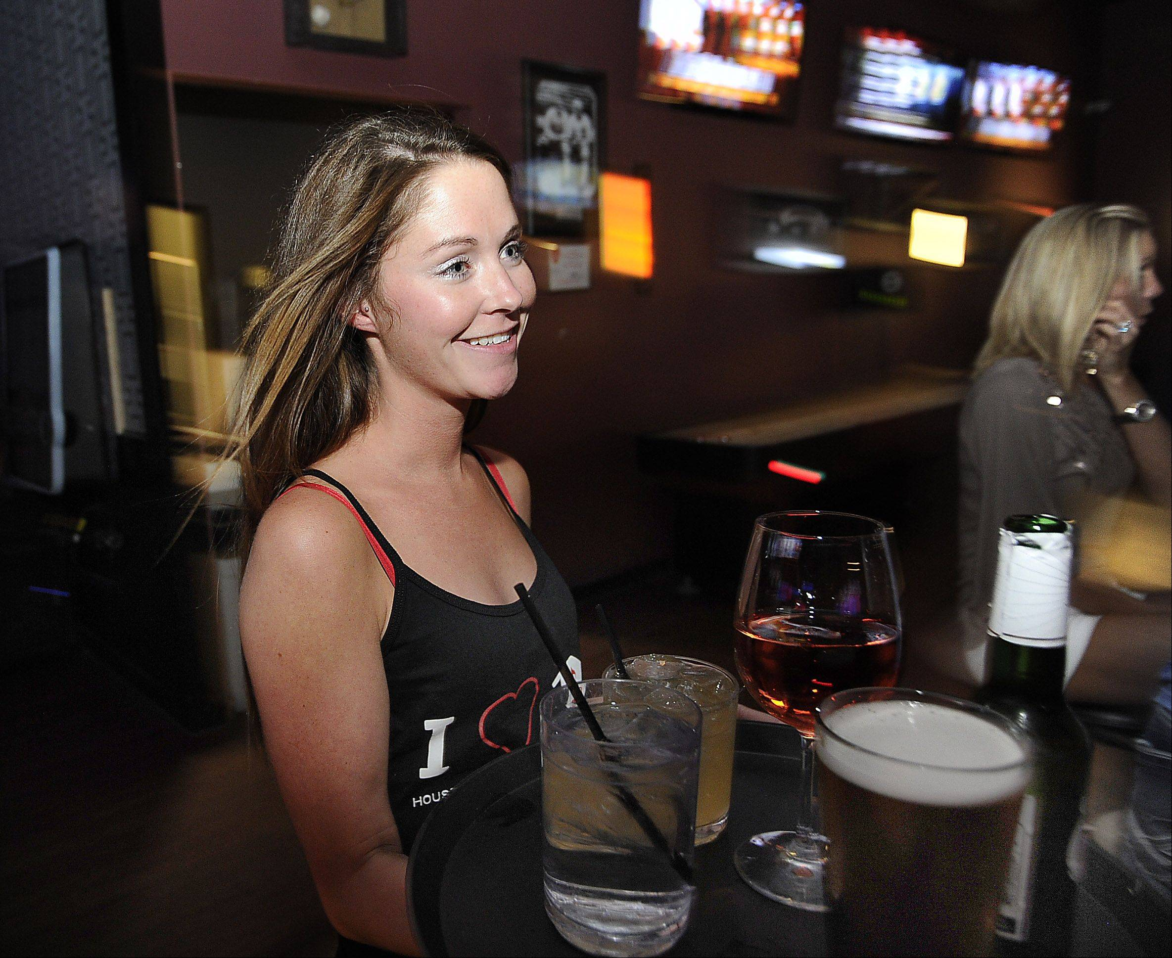 Bridget Hood serves drinks at the House of Music & Entertainment.