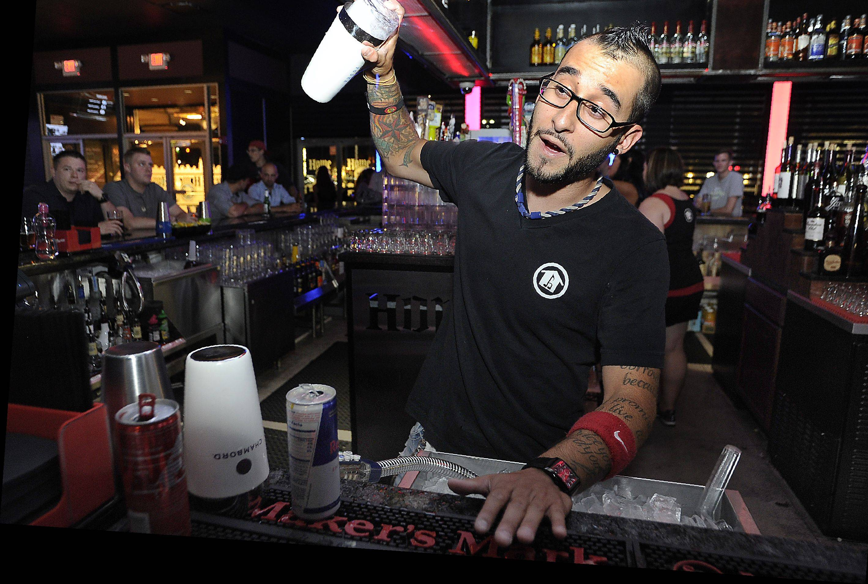 Bar manager Tony Herman mixes up drinks at the House of Music & Entertainment nightclub.