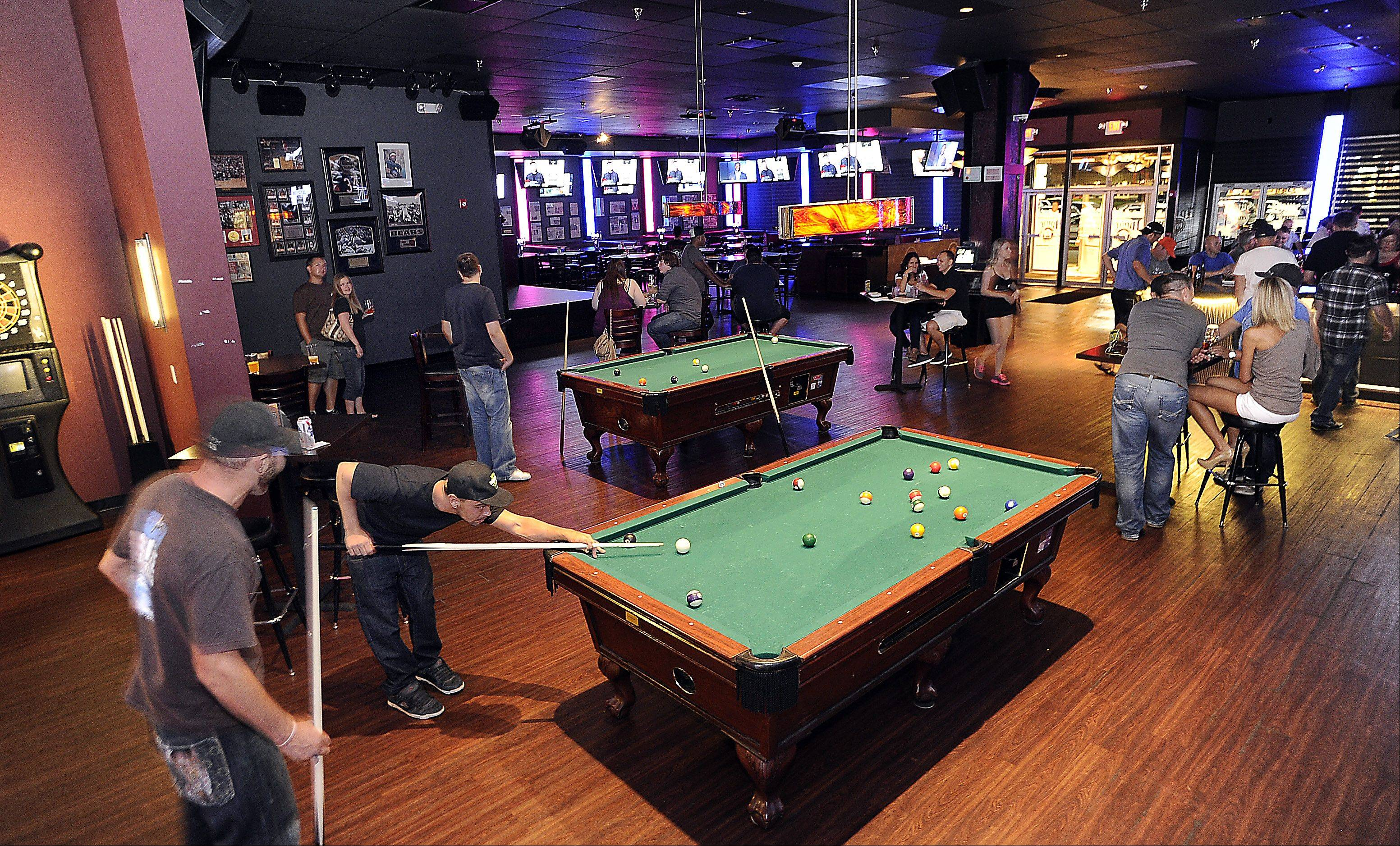 Pool tables provide a distraction in the sports bar side of the House of Music & Entertainment. A separate area hosts live entertainment.