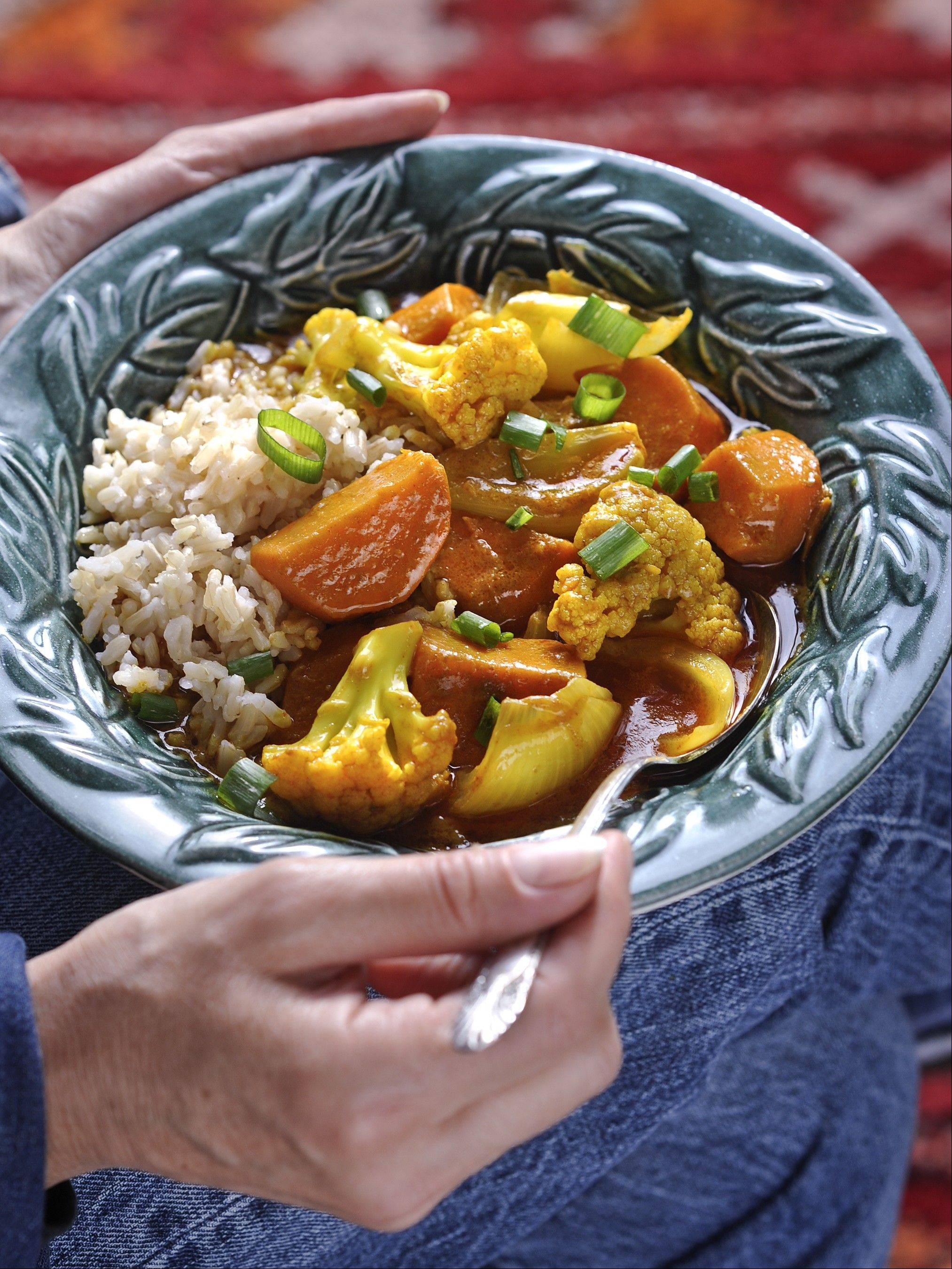 "Cauliflower takes on vibrant flavors in a stewlike Red Thai Curry from Barbara Damrosch and Eliot Coleman's ""The Four Season Farm Gardener's Cookbook."""