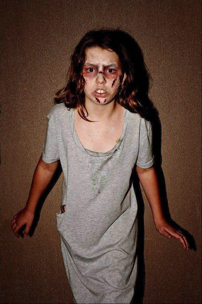 "Melanie Kerz, 11, dressed up as possessed Regan from 1973's ""The Exorcist"" at last year's Flashback Weekend, created by her father."