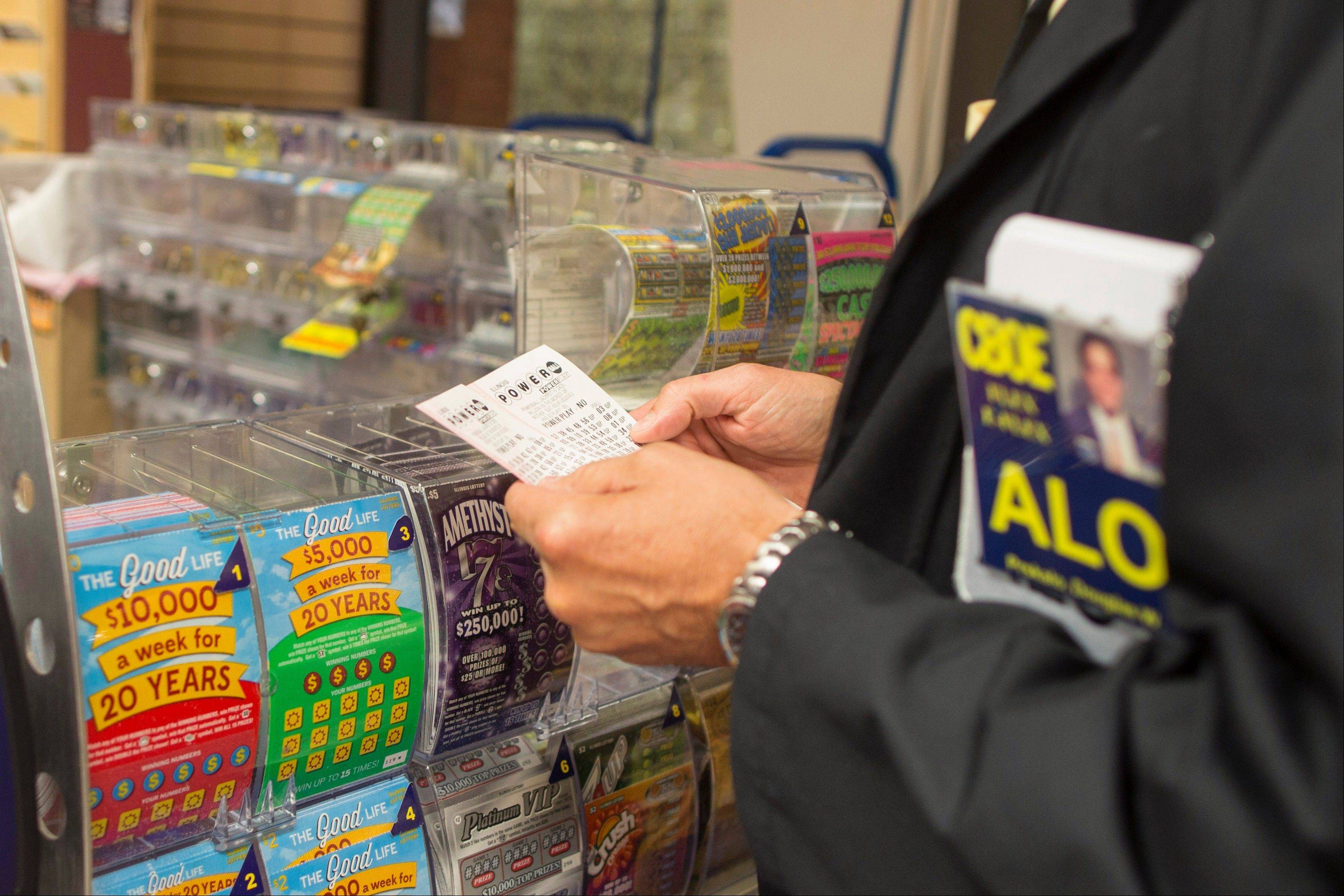 At least three people in two states will split the $448 million Powerball jackpot, after two winning tickets were sold in New Jersey and one was sold in Minnesota, lottery officials said Thursday.
