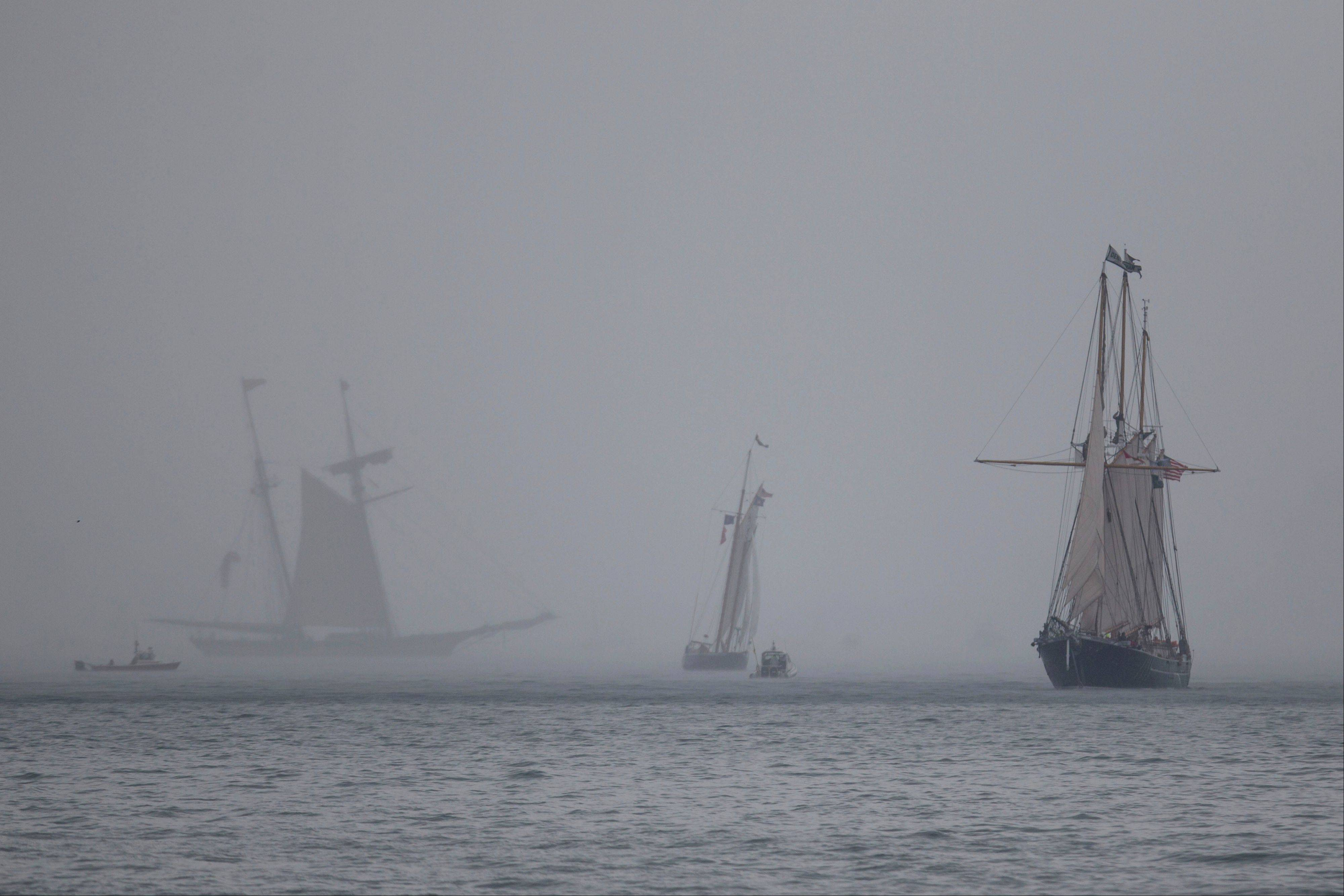 Tall Ships make their way toward Navy Pier in a parade in Chicago, Wednesday