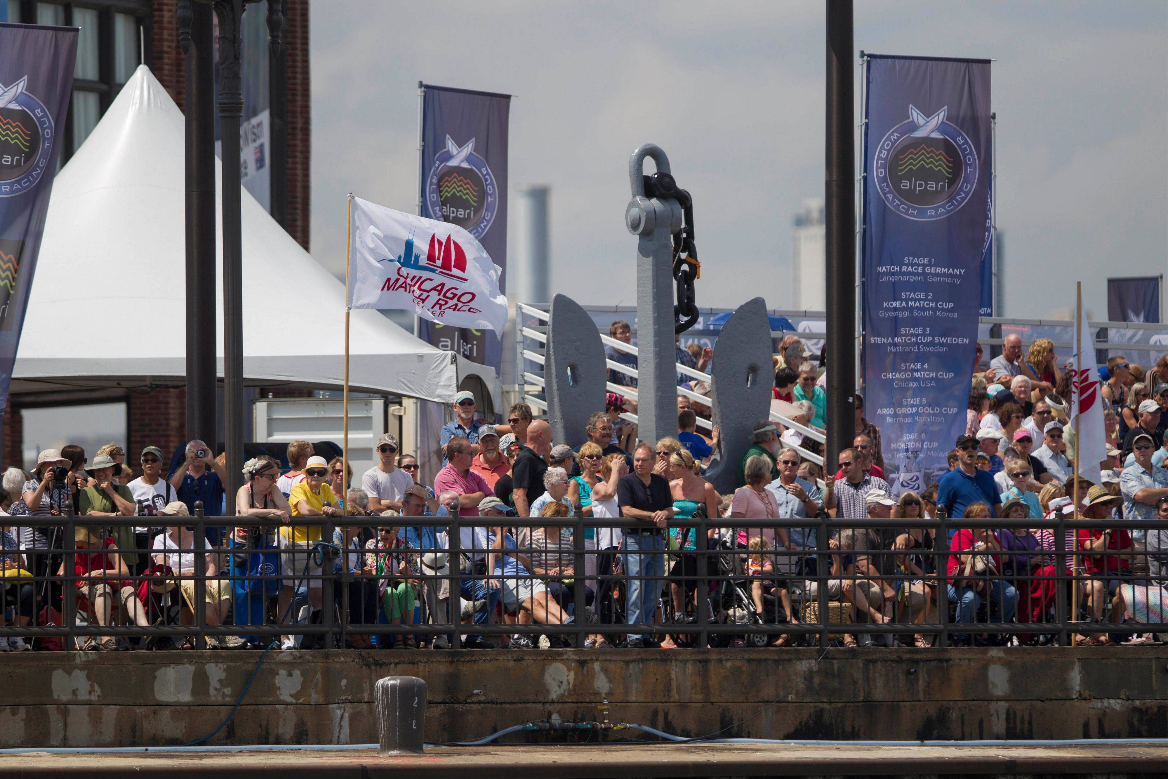 Spectators watch the Chicago Match Race compete on the Navy Pier in Chicago, Wednesday. The race runs through Sunday.