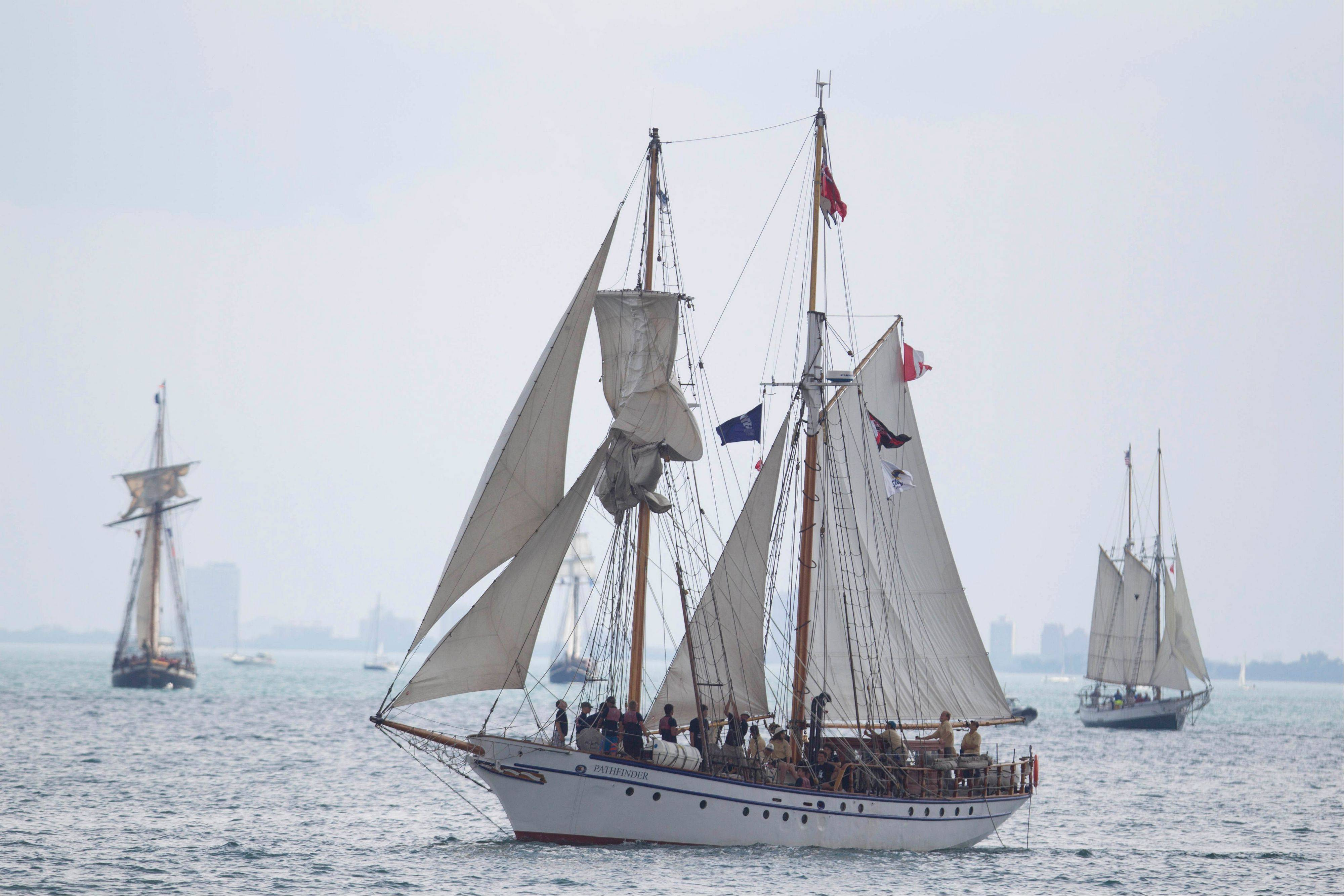 The Tall Ships make their way toward Navy Pier in a parade Wednesday in Chicago.