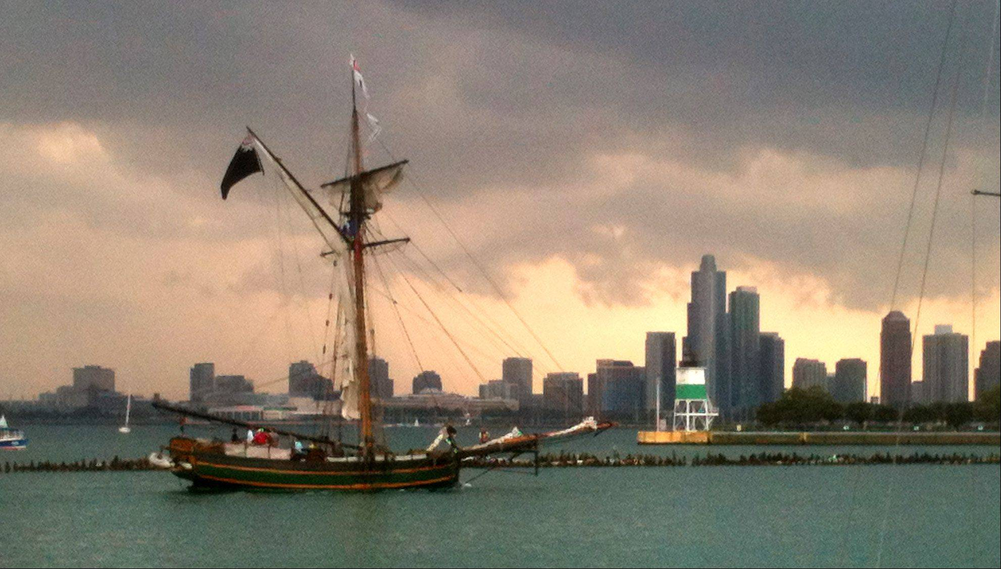 The Chicago skyline is the backdrop for 14 tall ships setting sail off Navy Pier on Wednesday.