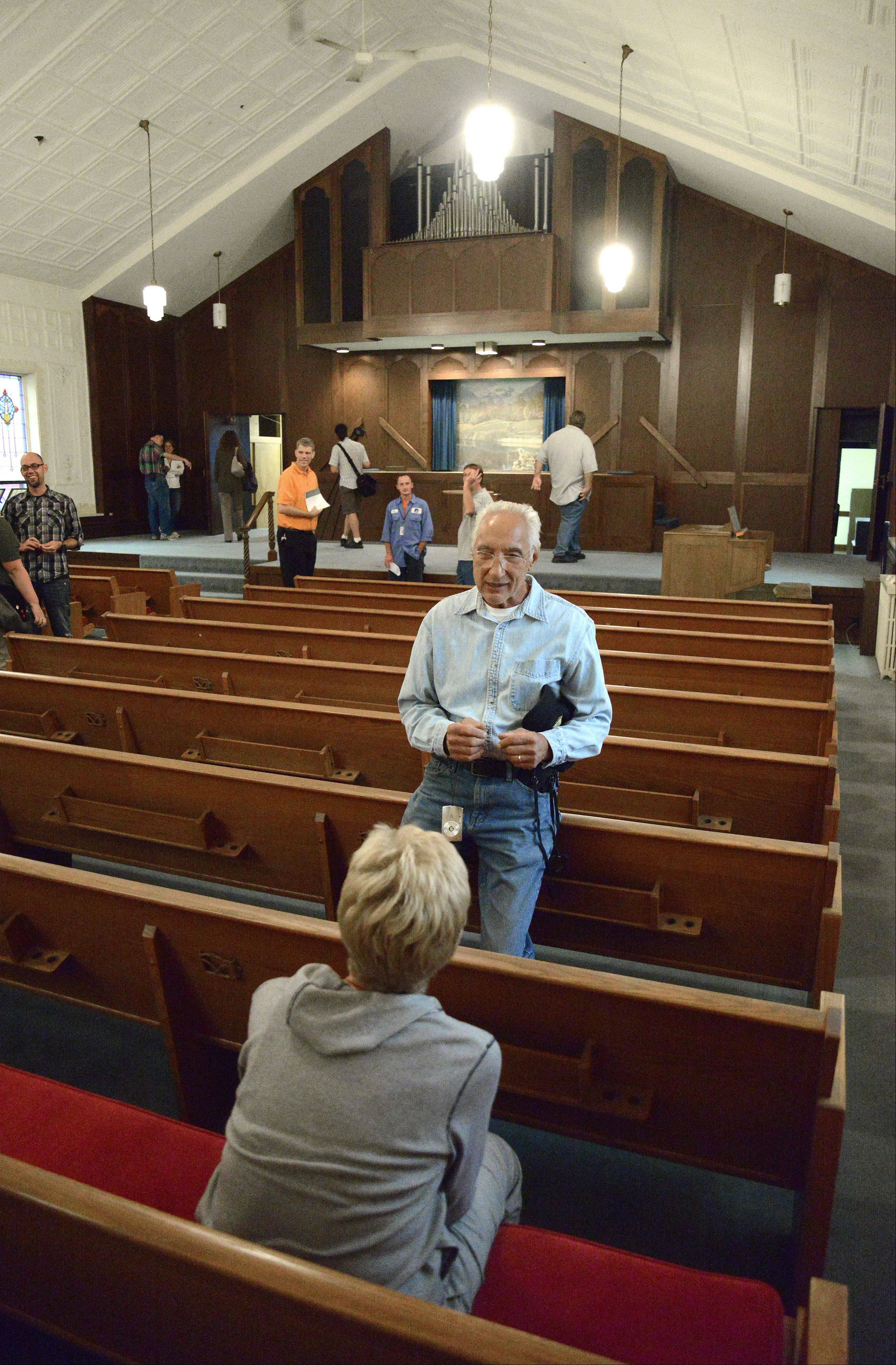 People recall attending church in the First Baptist Church of Batavia sanctuary, during an open house June 30. The city owns the building, and is considering letting any potential buyer tear it down.