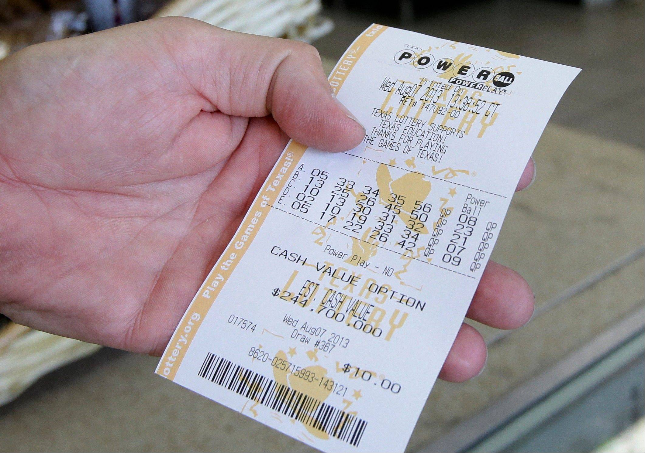 A customer reviews the numbers Wednesday after making a purchase on a Powerball ticket. The Powerball jackpot is expected to be about $425 million by Wednesday's drawing, making it the game's third largest ever.