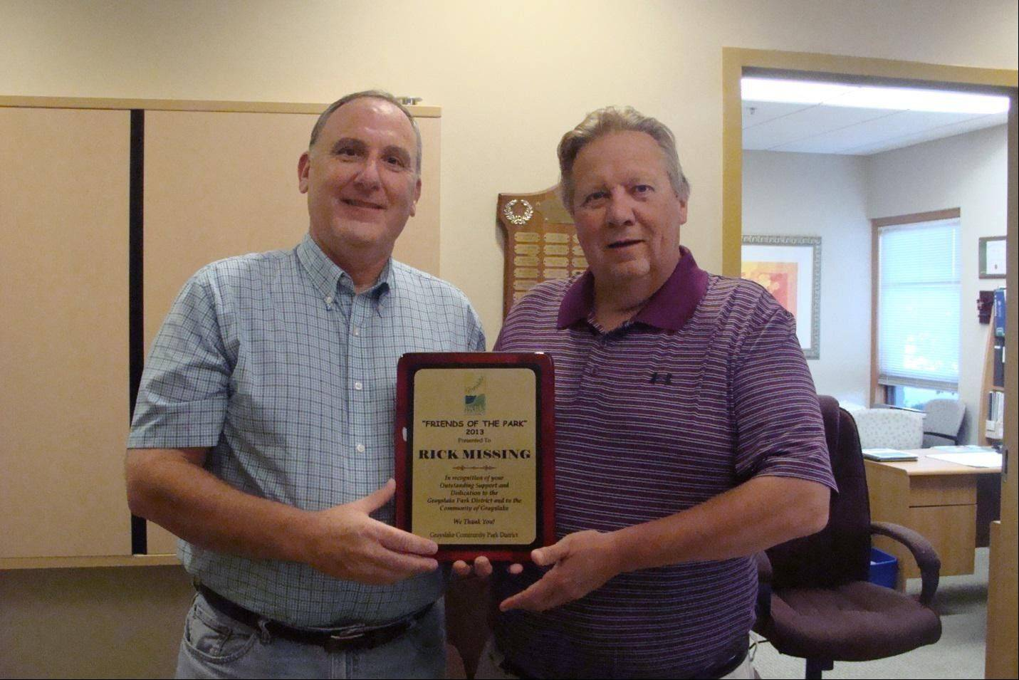 Grayslake Park Board President Ken Ryan presents the 2013 Friends of the Park Award to Rick Missing.