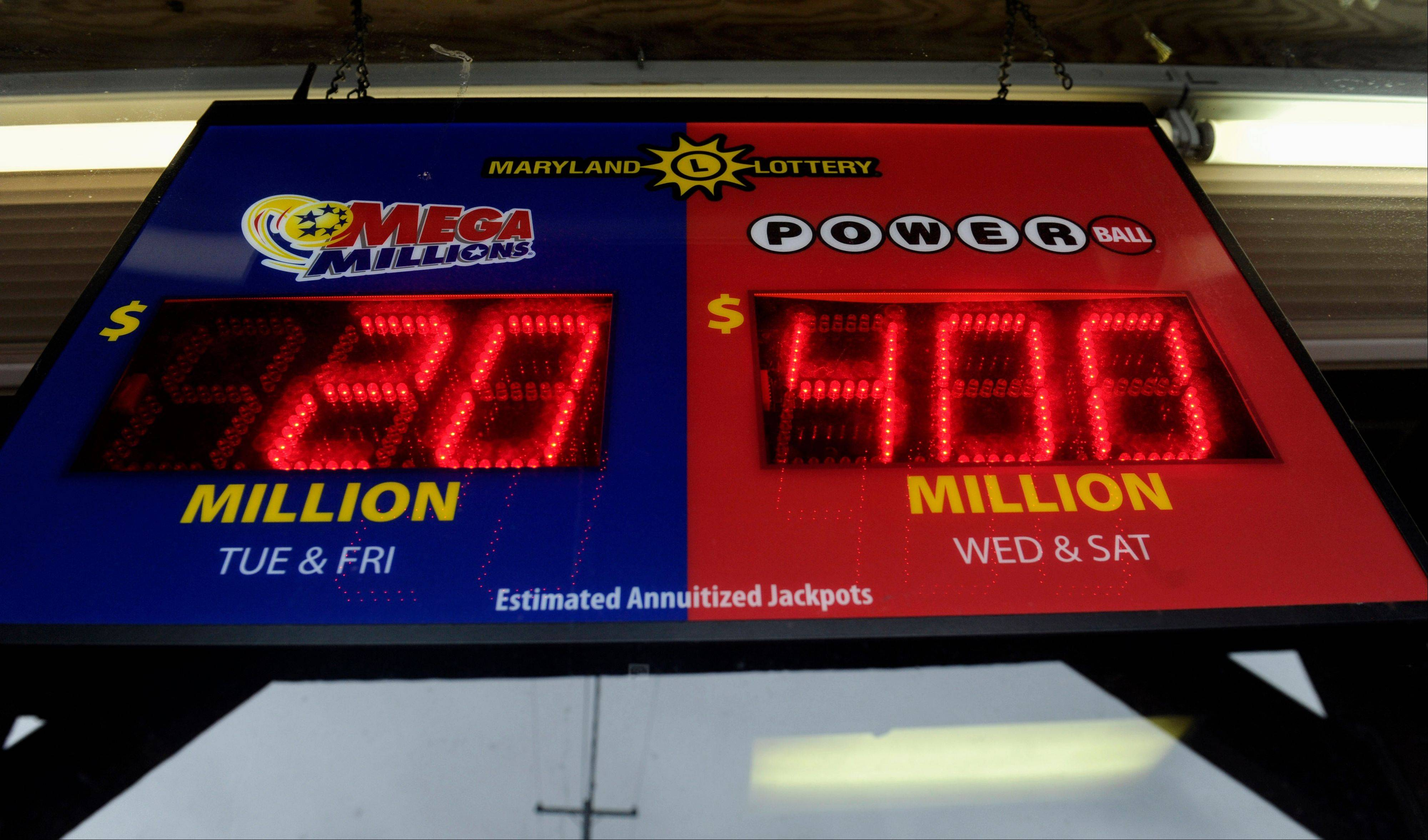 A sign showing the estimated winnings of the Powerball lottery jackpot, $400 million, right, hangs in the window of Rip's Wine and Spirits Shop in Bowie, Md., Tuesday, Aug. 6, 2013.