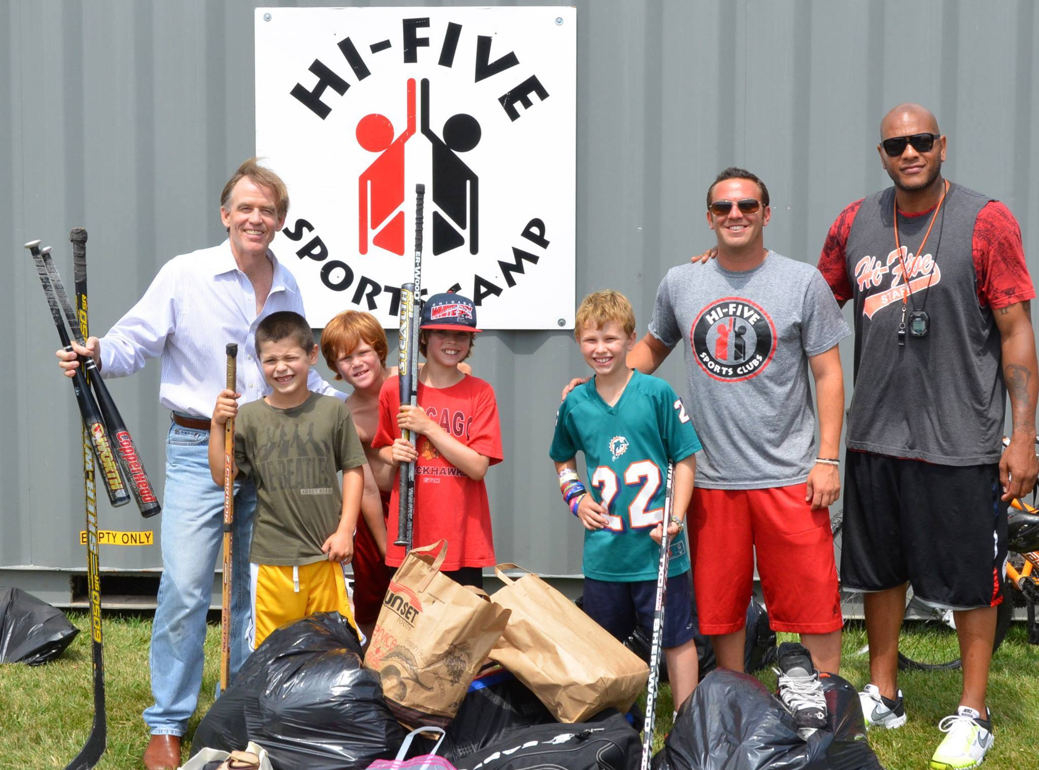 Gear for Goals' Executive Director Dr. Warren Bruhl poses with Danny Tuchman and Donnell Thomas with campers from Hi-Five Sports Camp who donated gear to benefit needy kids in the Dominican Republic and Kenya.