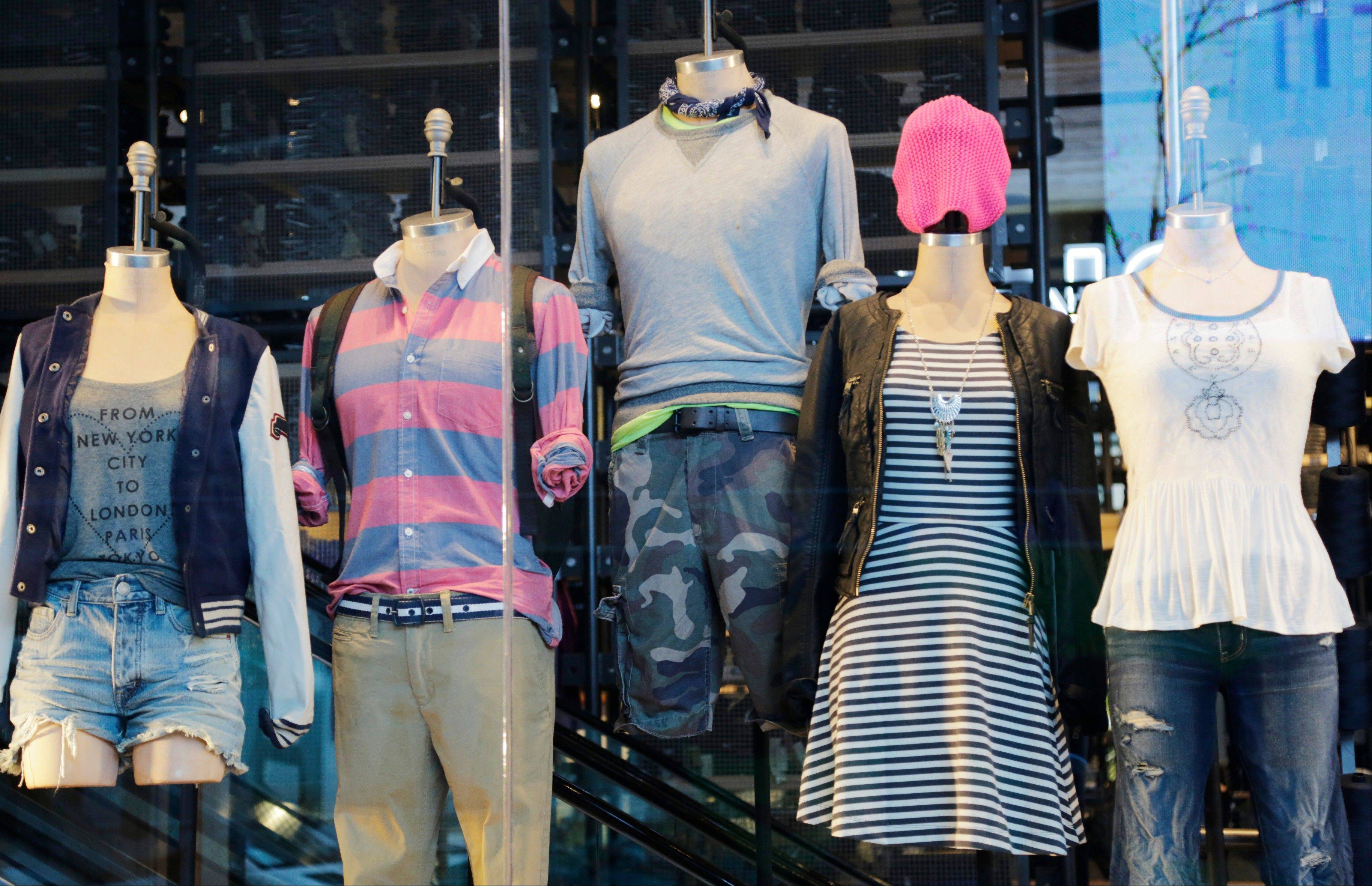 In this photo of July 31, 2013, back-to school fashions are displayed at American Eagle Outfitters in New York's Times Square.S hoppers, worried about their finances, showed they were more interested in buying discounted summer merchandise in July than in picking up new fall clothing for their children, according to figures released Thursday, Aug. 8, 2013. (AP Photo/Mark Lennihan)