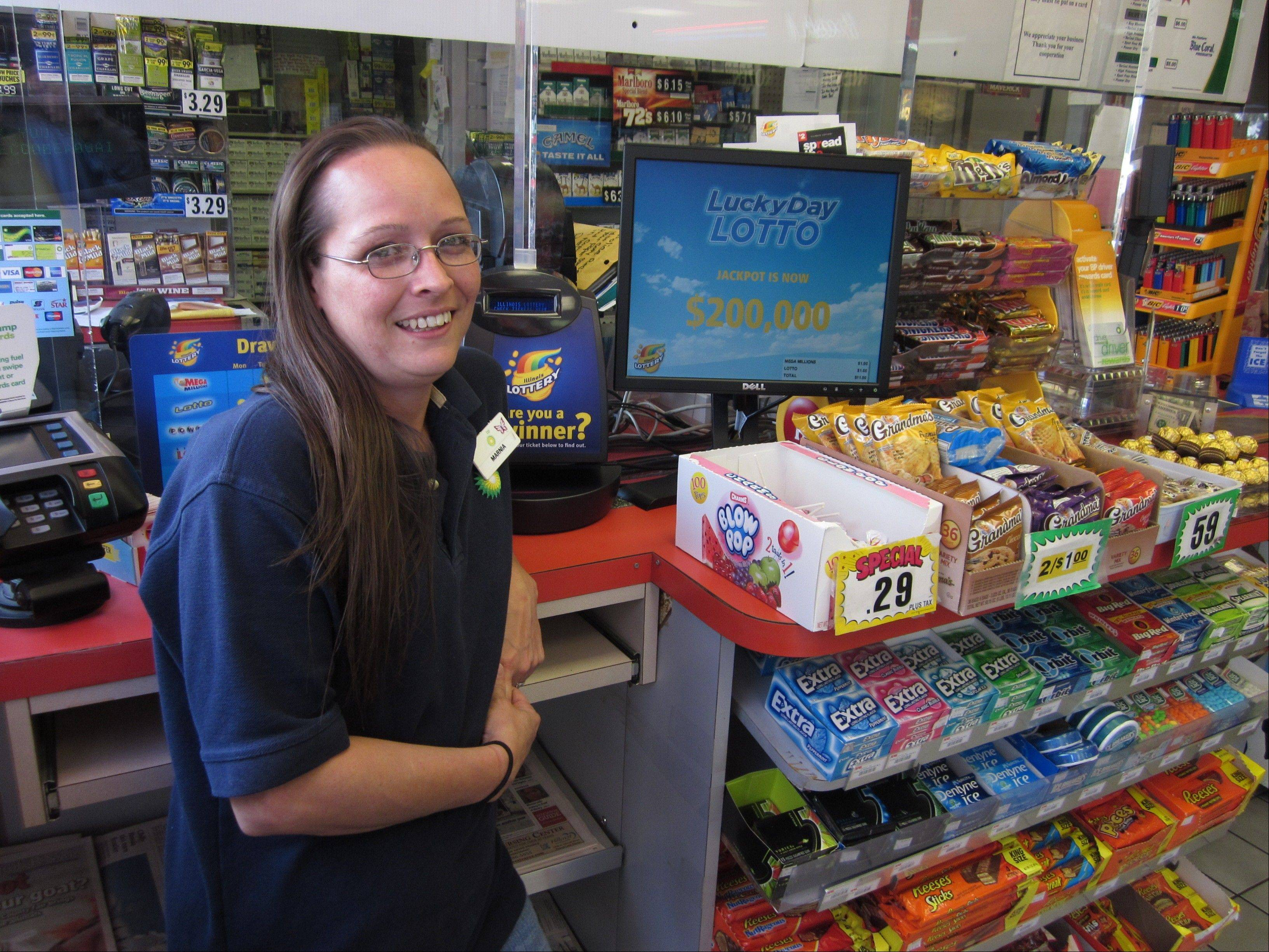 Marnia Chapai manages the Round Lake BP gasoline station where a customer purchased a winning Powerball lottery ticket worth $1 million. The Powerball numbers were drawn Wednesday night.