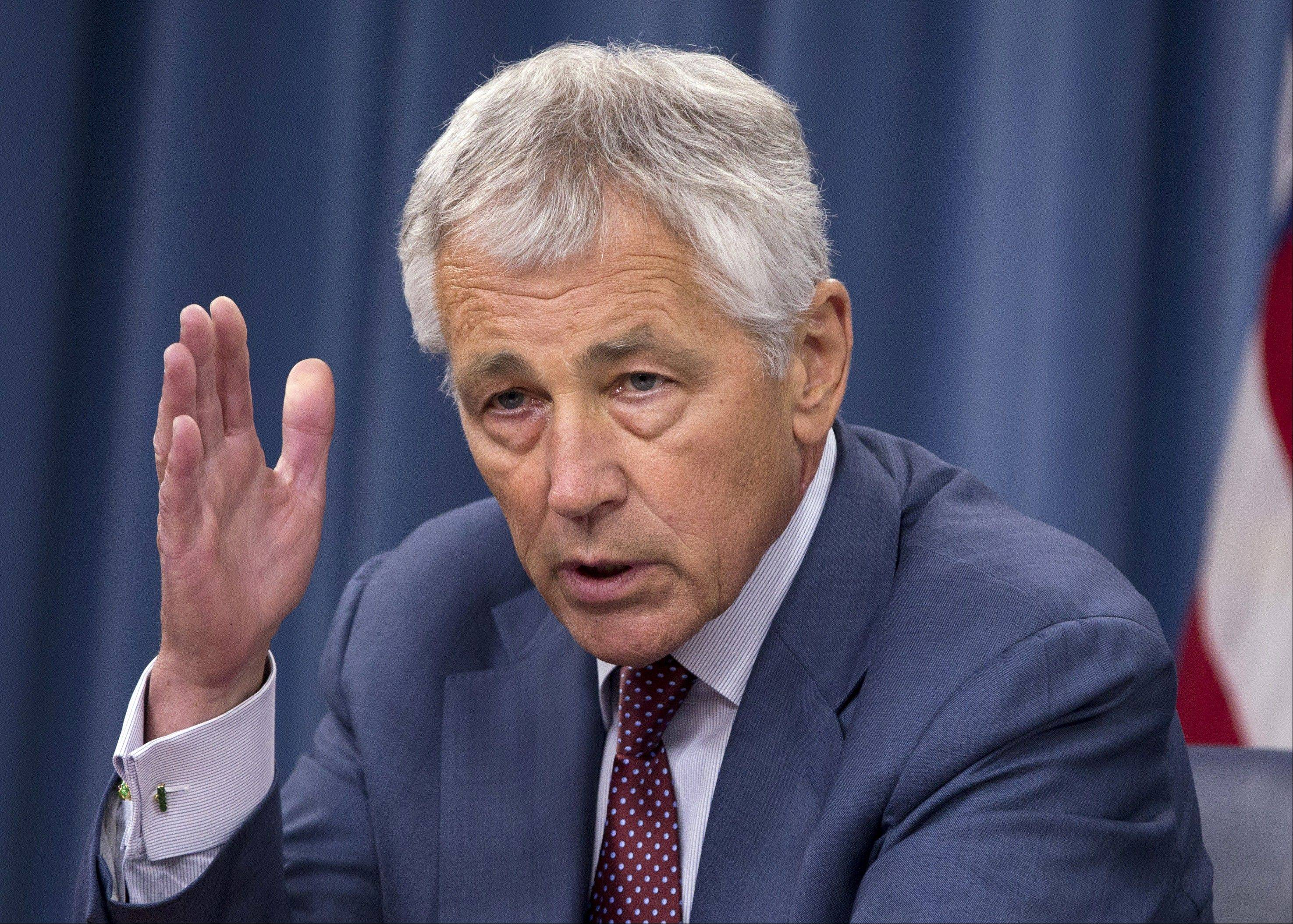 In this July 31, 2013, file photo, Defense Secretary Chuck Hagel speaks during a news conference at the Pentagon. The Pentagon is poised to extend health care, housing and other benefits to the same-sex spouses of military members by the end of August, but may reverse earlier plans to provide benefits to gay partners who are not married.
