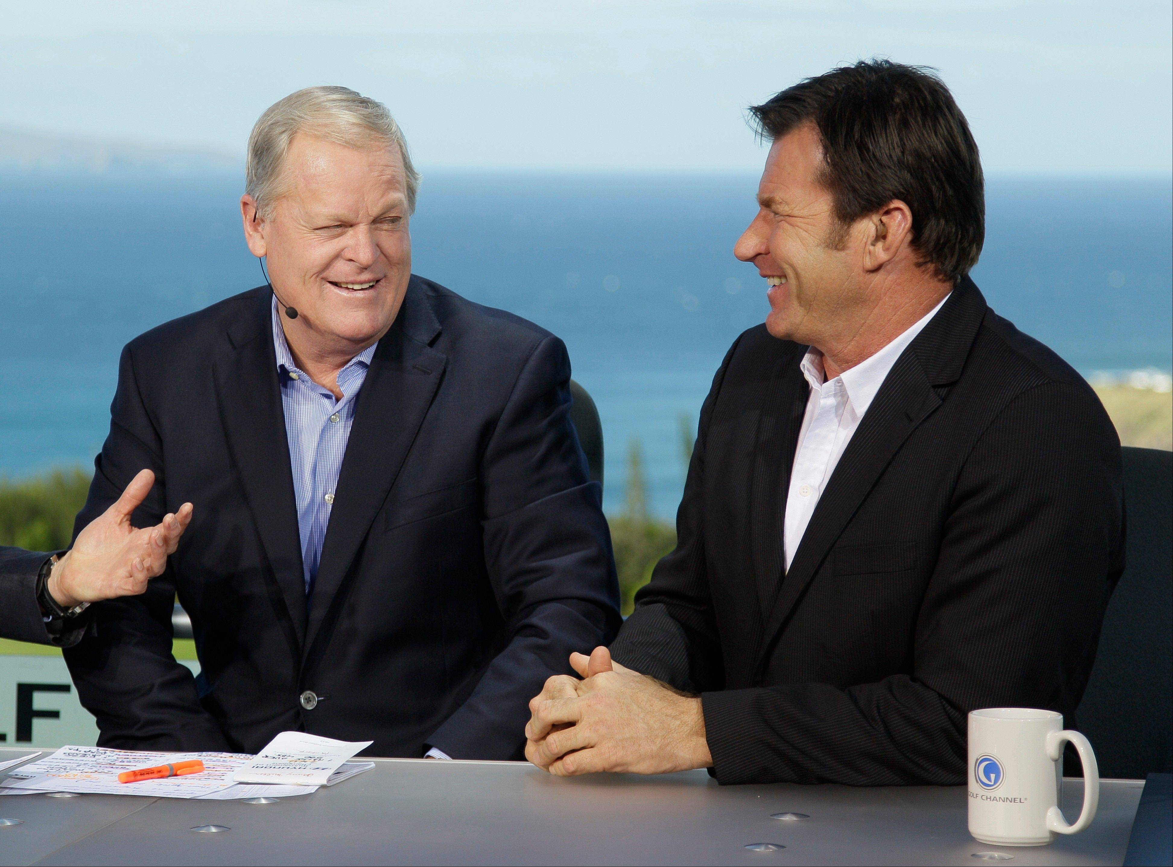 Johnny Miller, left, and Nick Faldo, right, laugh while being introduced at the beginning of a Golf Channel broadcast during the first round of the Hyundai Tournament of Champions PGA Tour golf tournament. Fox Sports is in as the broadcast partner for the U.S. Open starting in 2015. Miller appears to be out.