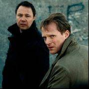 "Two British police officer brothers (Stephen Graham, left, and Paul Bettany) discover that guilt can be a powerful weapon for justice in ""Blood."""