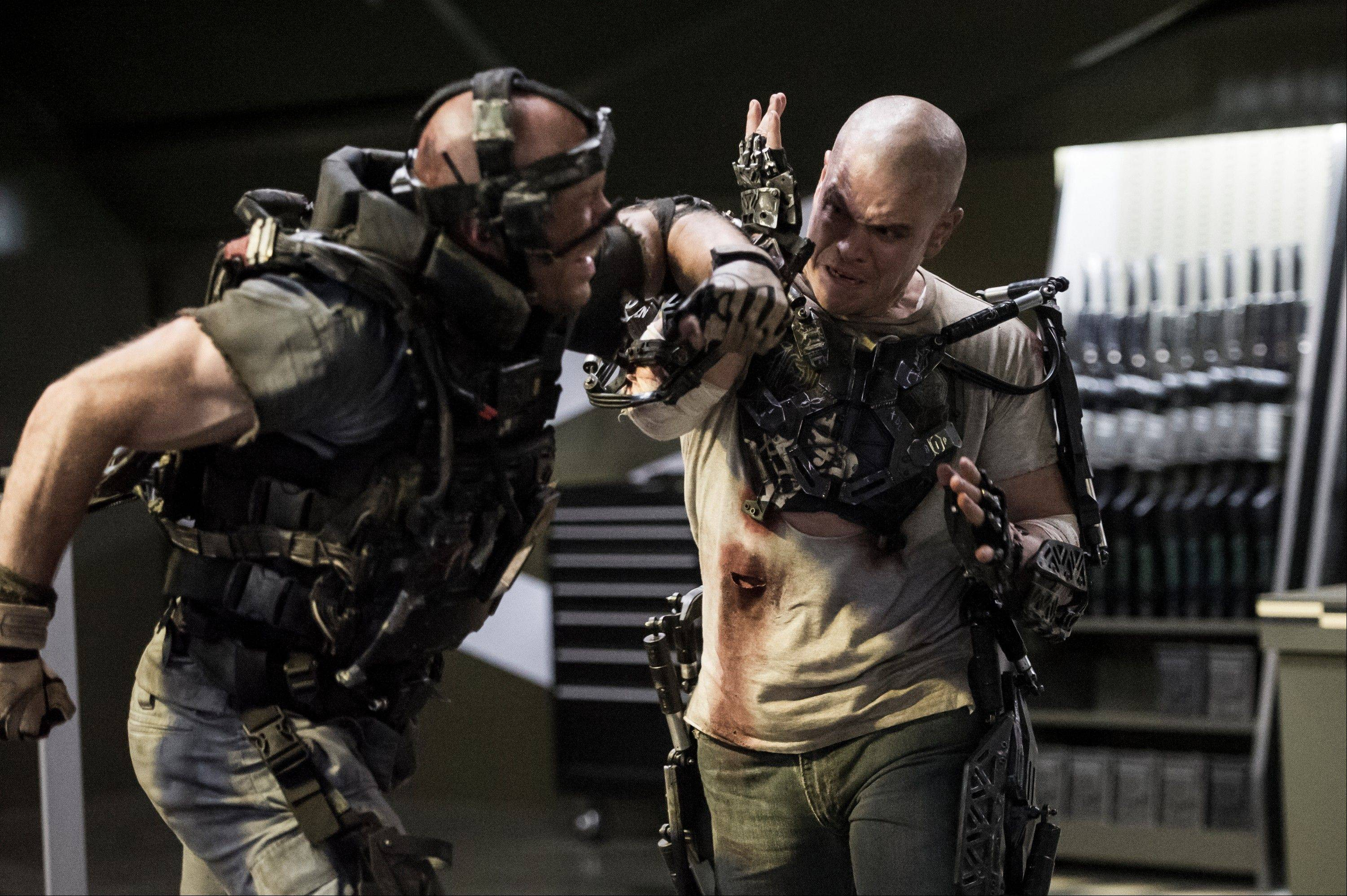 "Max (Matt Damon), right, beats up a government thug trying to kill him in the spectacular, but botched science-fiction thriller ""Elysium."""