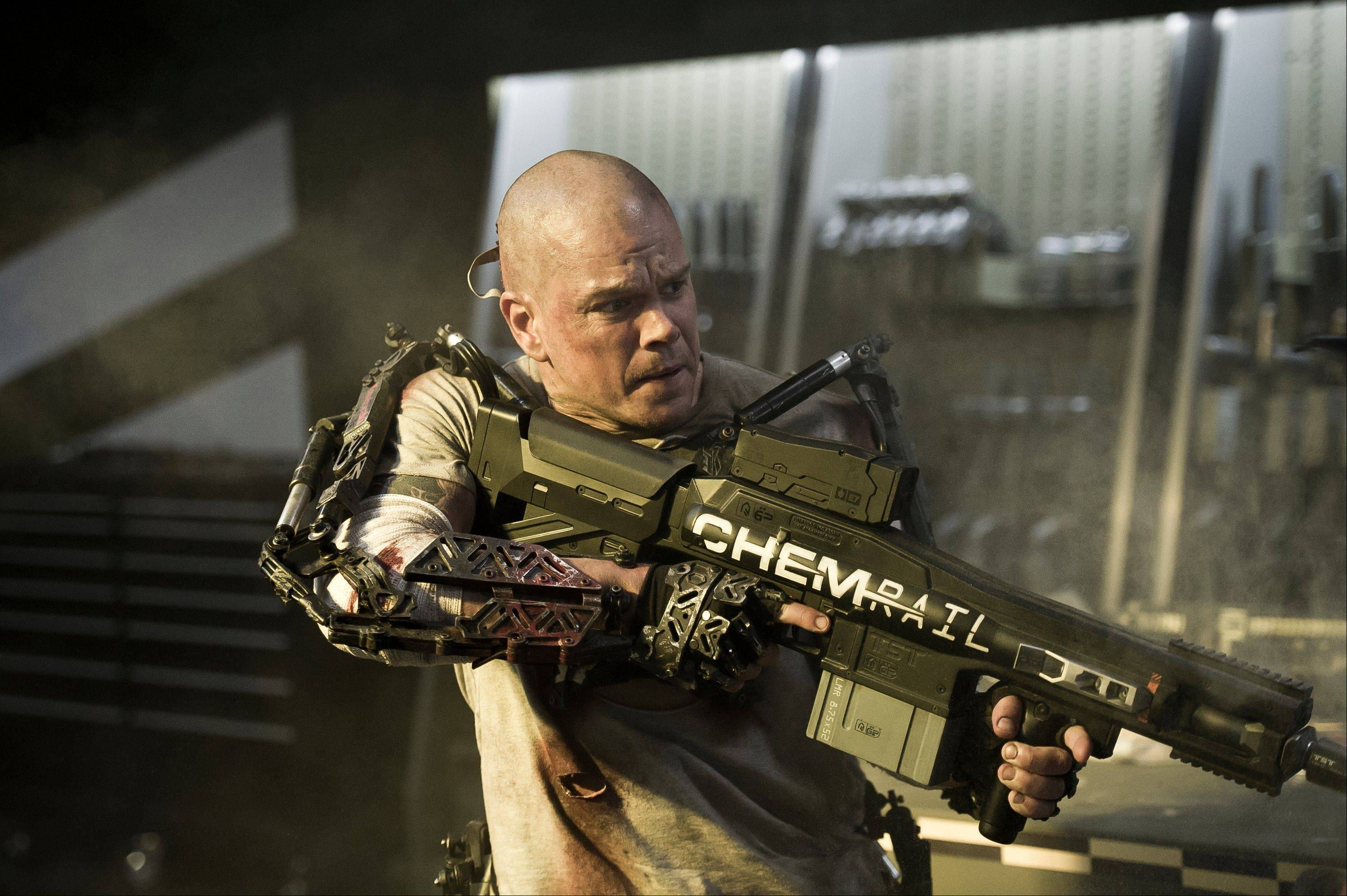"Mad Max (Matt Damon) retaliates against government agents working for the wealthy elite community aboard a satellite in the science-fiction thriller ""Elysium."""