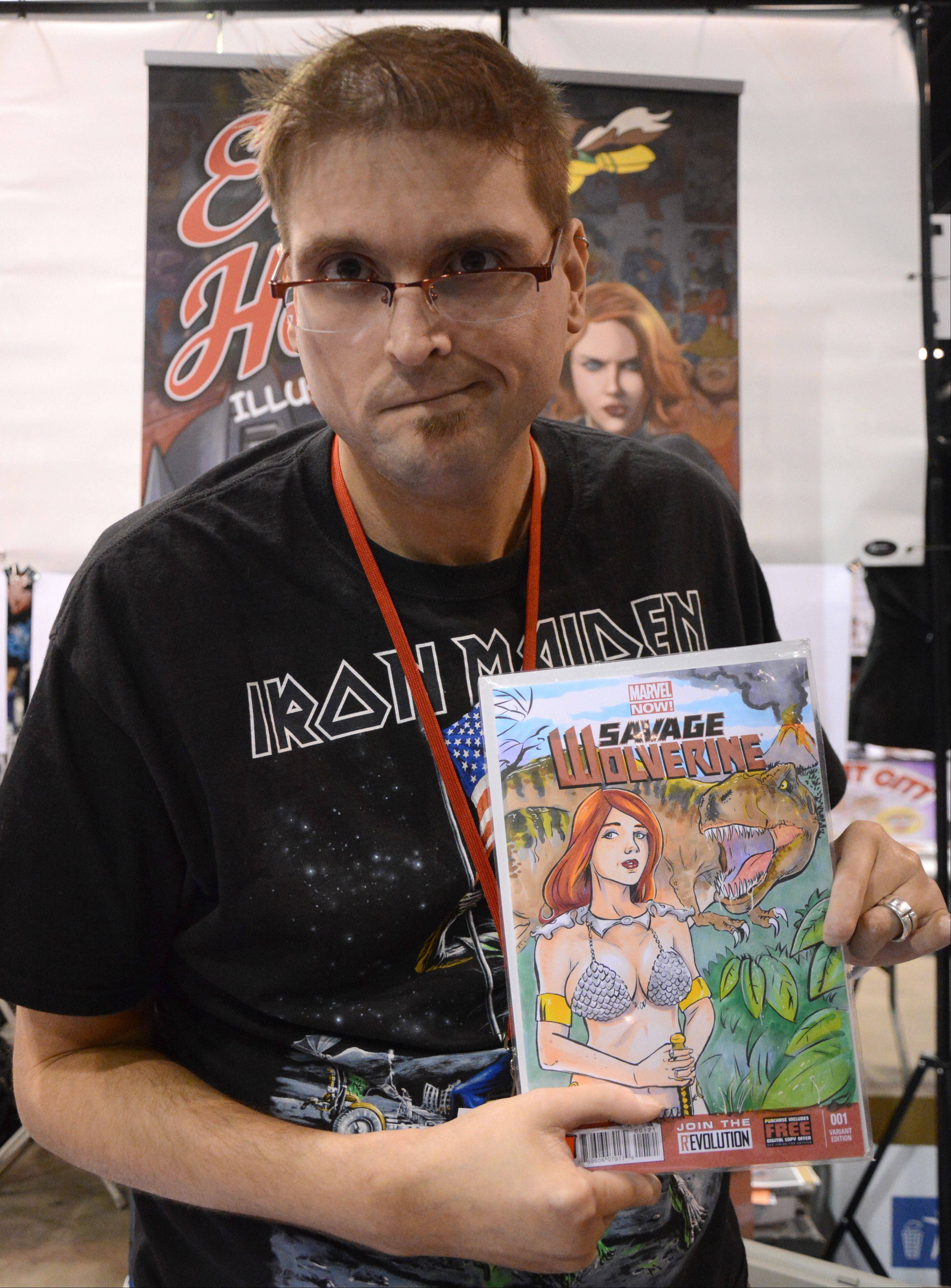 Erik Hodson, of Detroit, poses with some of his artwork at Chicago Comic Con. Hodson was diagnosed with scleroderma, a connective tissue disease that has affected his hands, but he has since retrained himself so he can continue to draw.