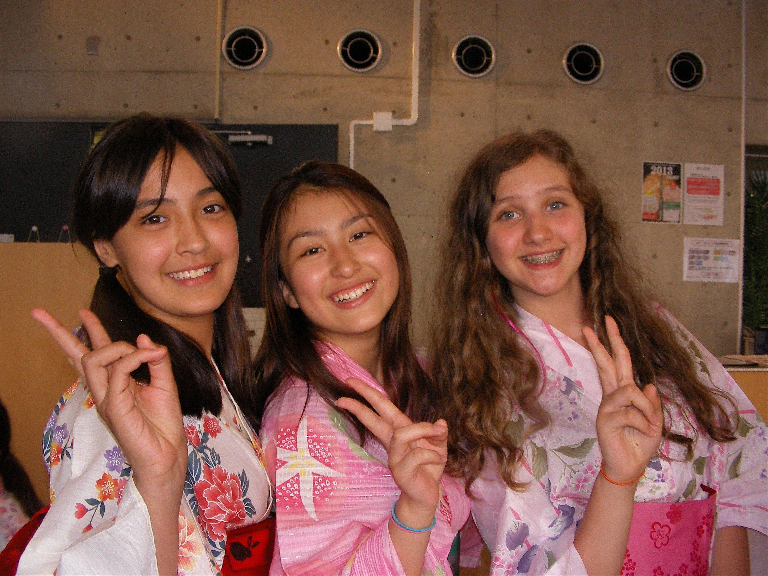 Girls are in summer yukatas. From left to right, Emma Rogers, Erica Ross and Amanya Meir.